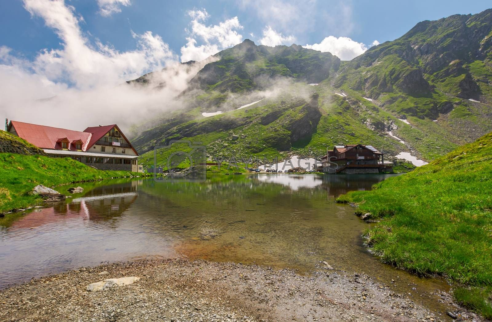 rising clouds on lake Balea. beautiful summer landscape of popular tourist attraction. one of the most visited locations near the Tranfagarasan road