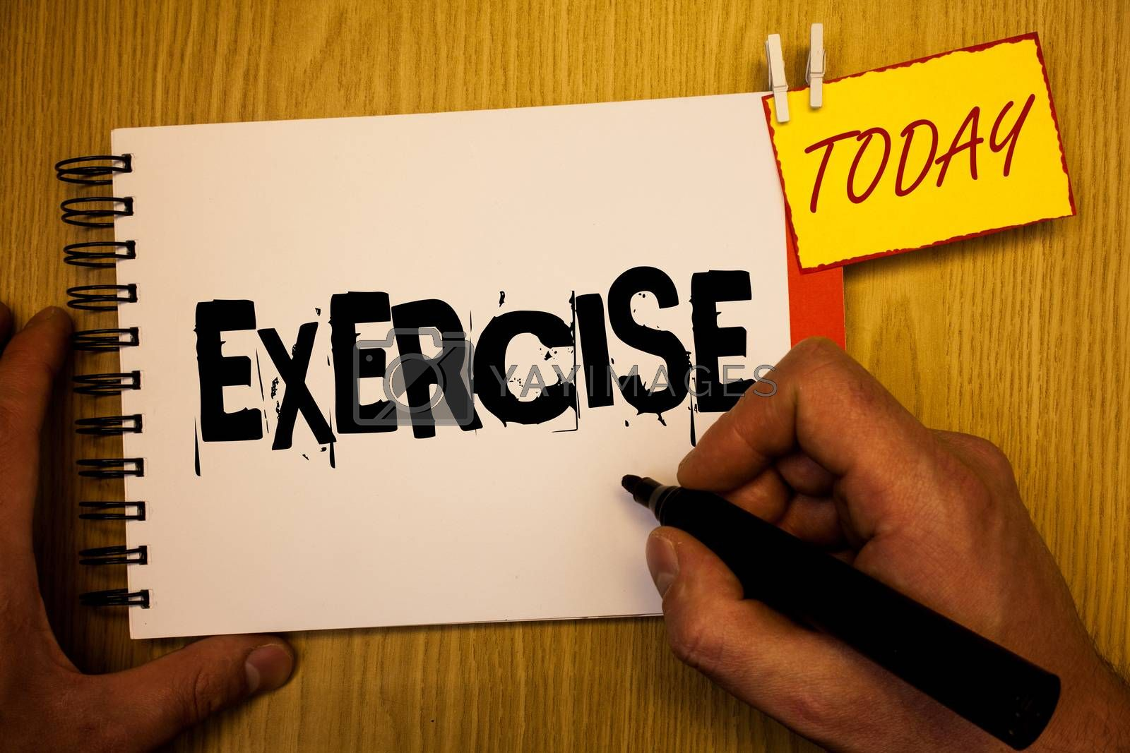Handwriting text writing Exercise. Concept meaning Activity requiring physical effort Bringing into play Training Man hold holding black marker notebook clothespin today wooden table