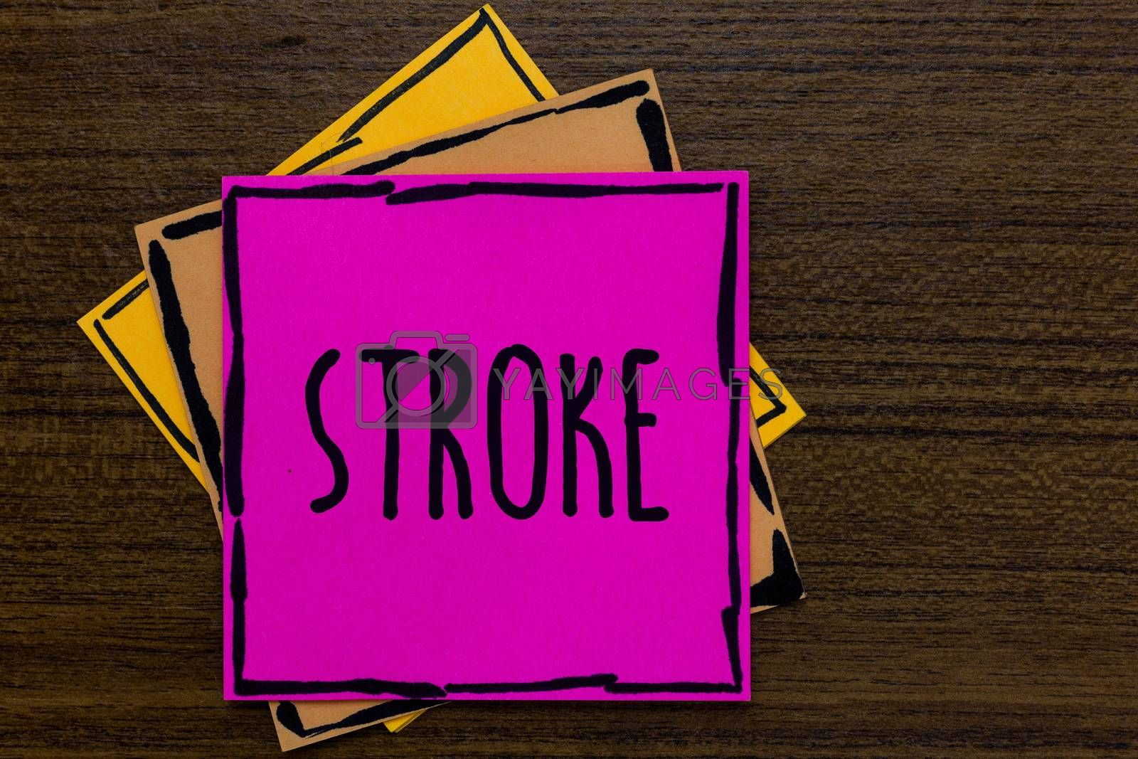 Writing note showing Stroke. Business photo showcasing Patients losing consciousness due to poor blood flow medical Three art small paper two yellow one pink wood brown lite grey shadow