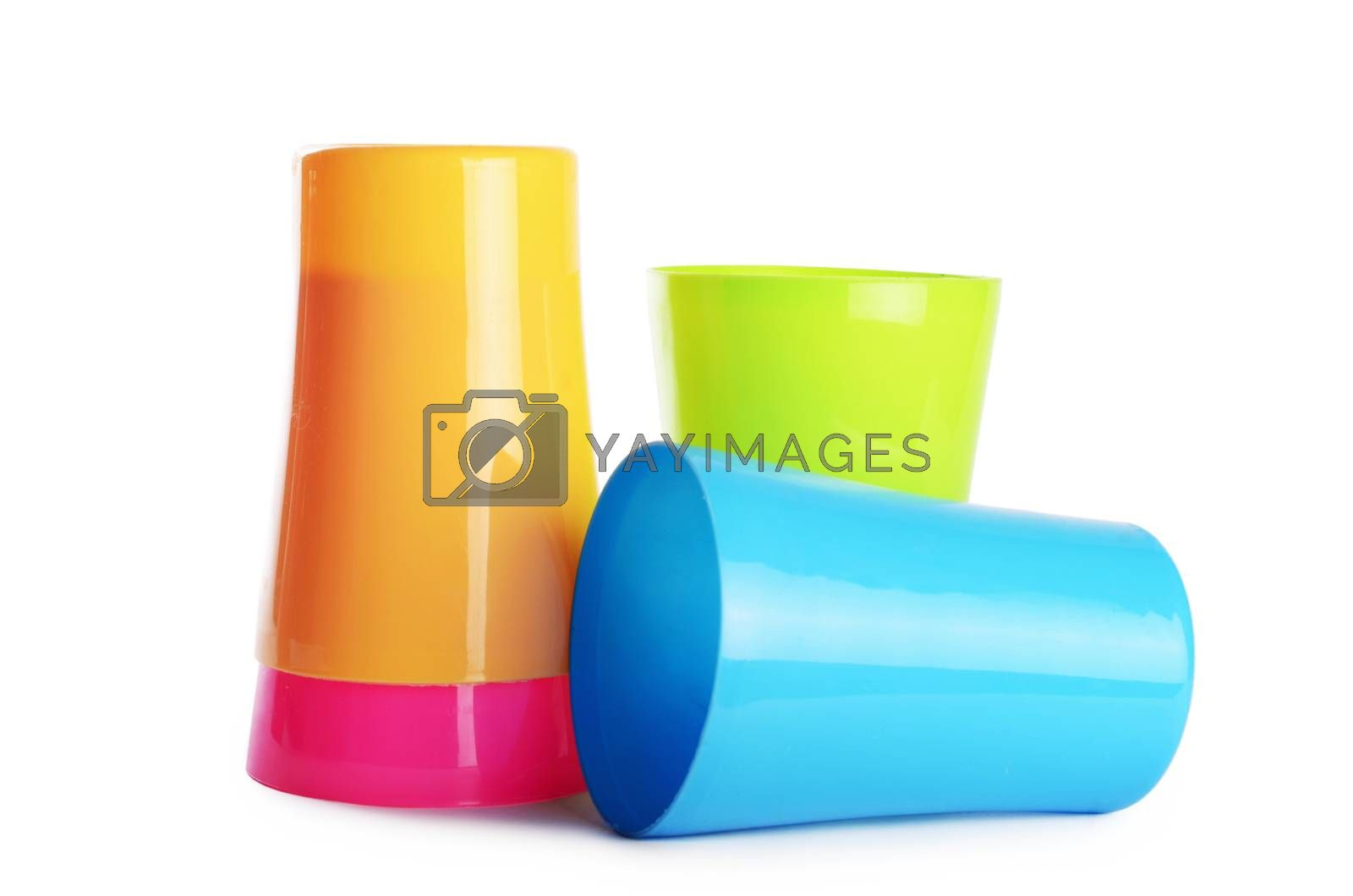 Plastic colorful cups isolated on white background