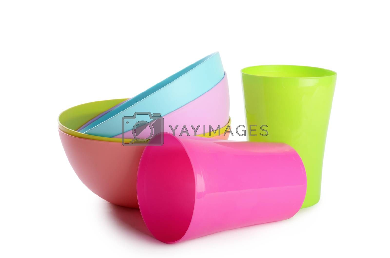 Plastic cups and plates isolated on white