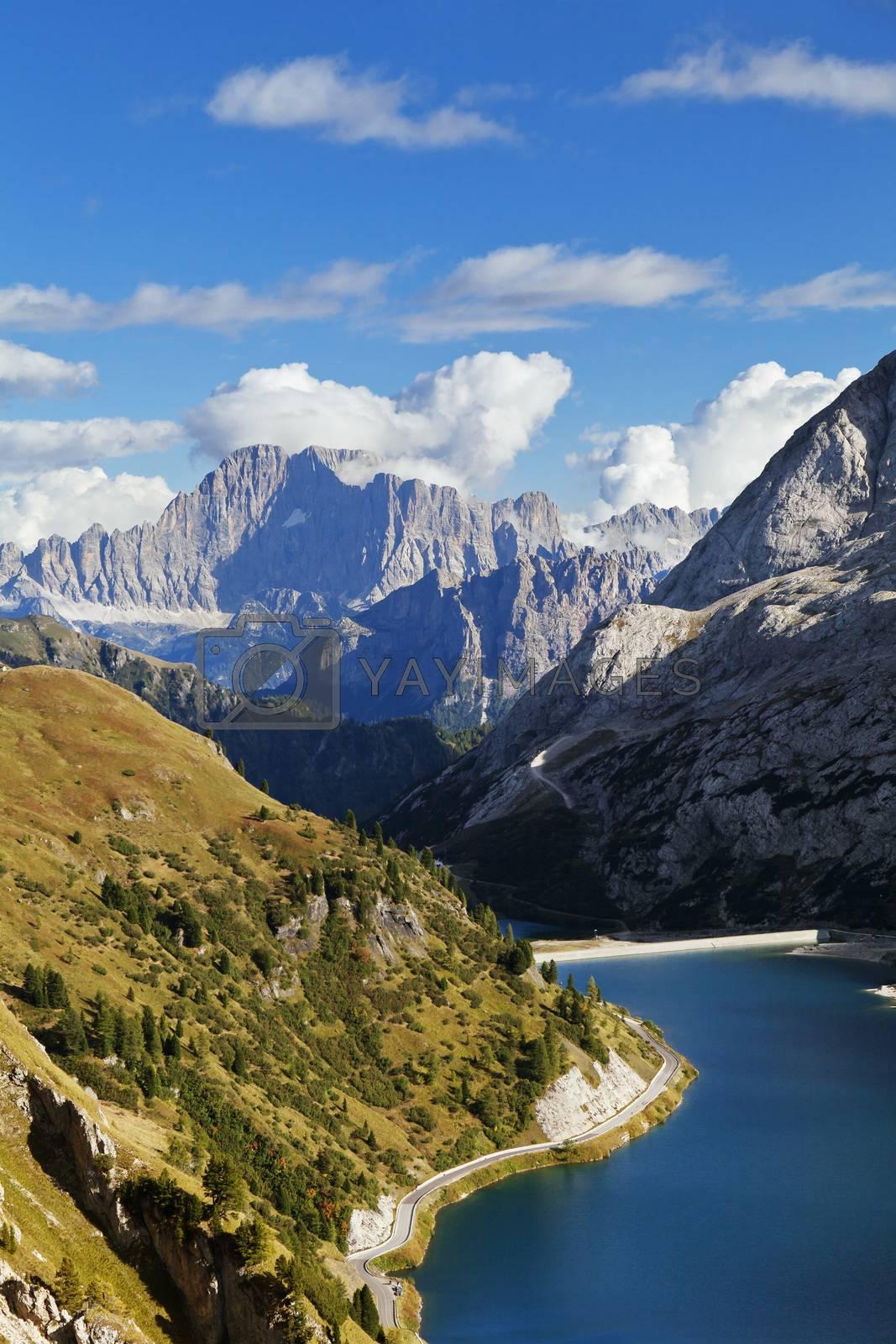Fedaia lake in Dolomites with view of Marmolada mountain