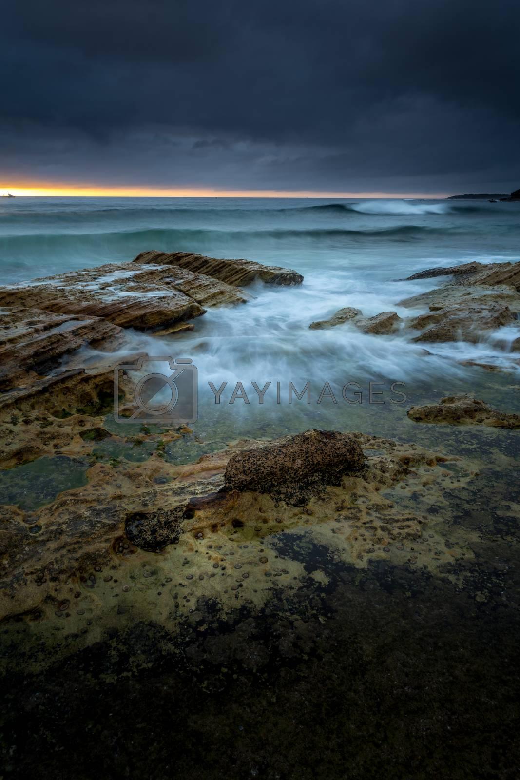 Moody morning with rain and sunshine at Cronulla Beach