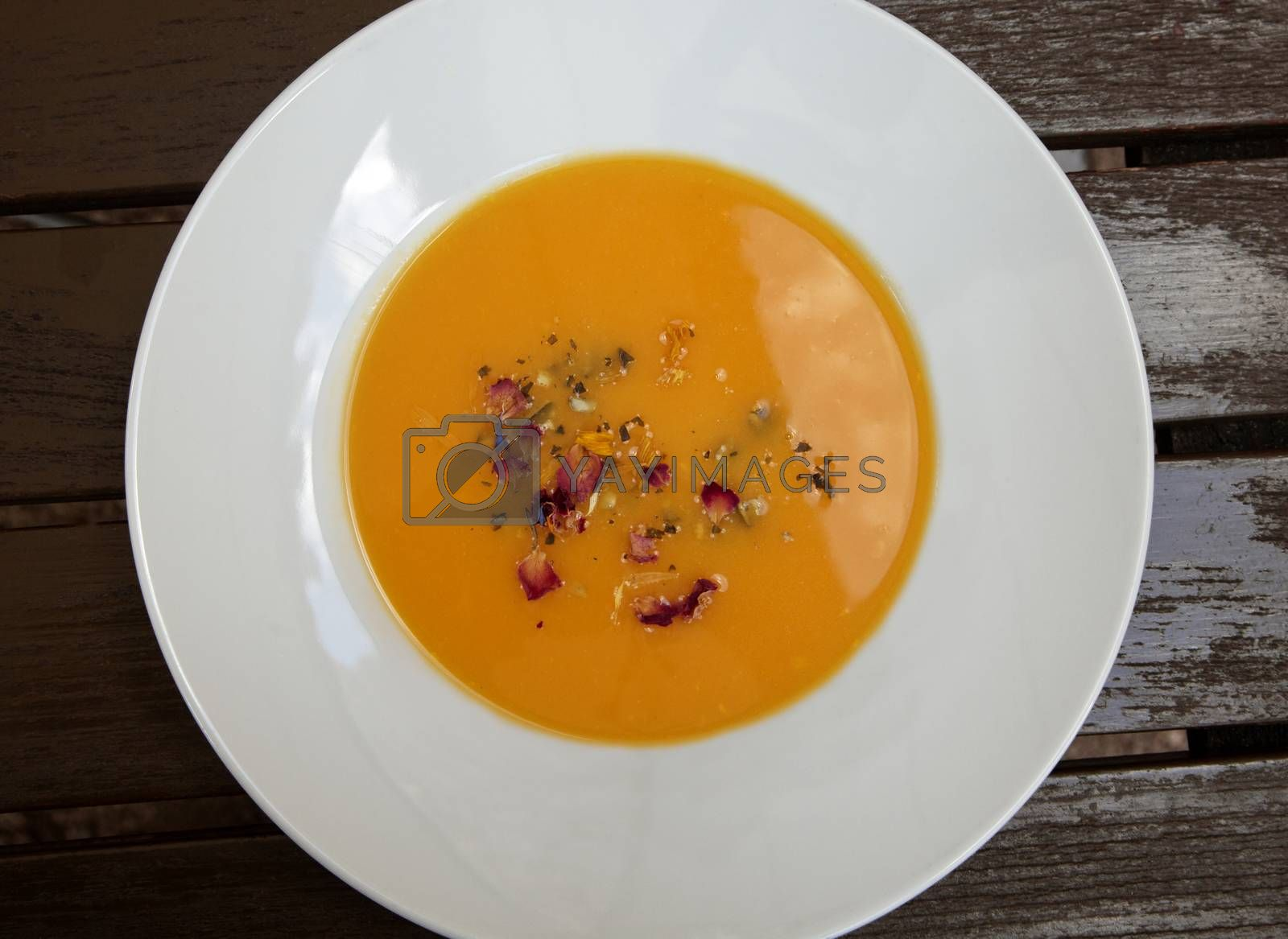 Pumpkin soup in a plate, view from above