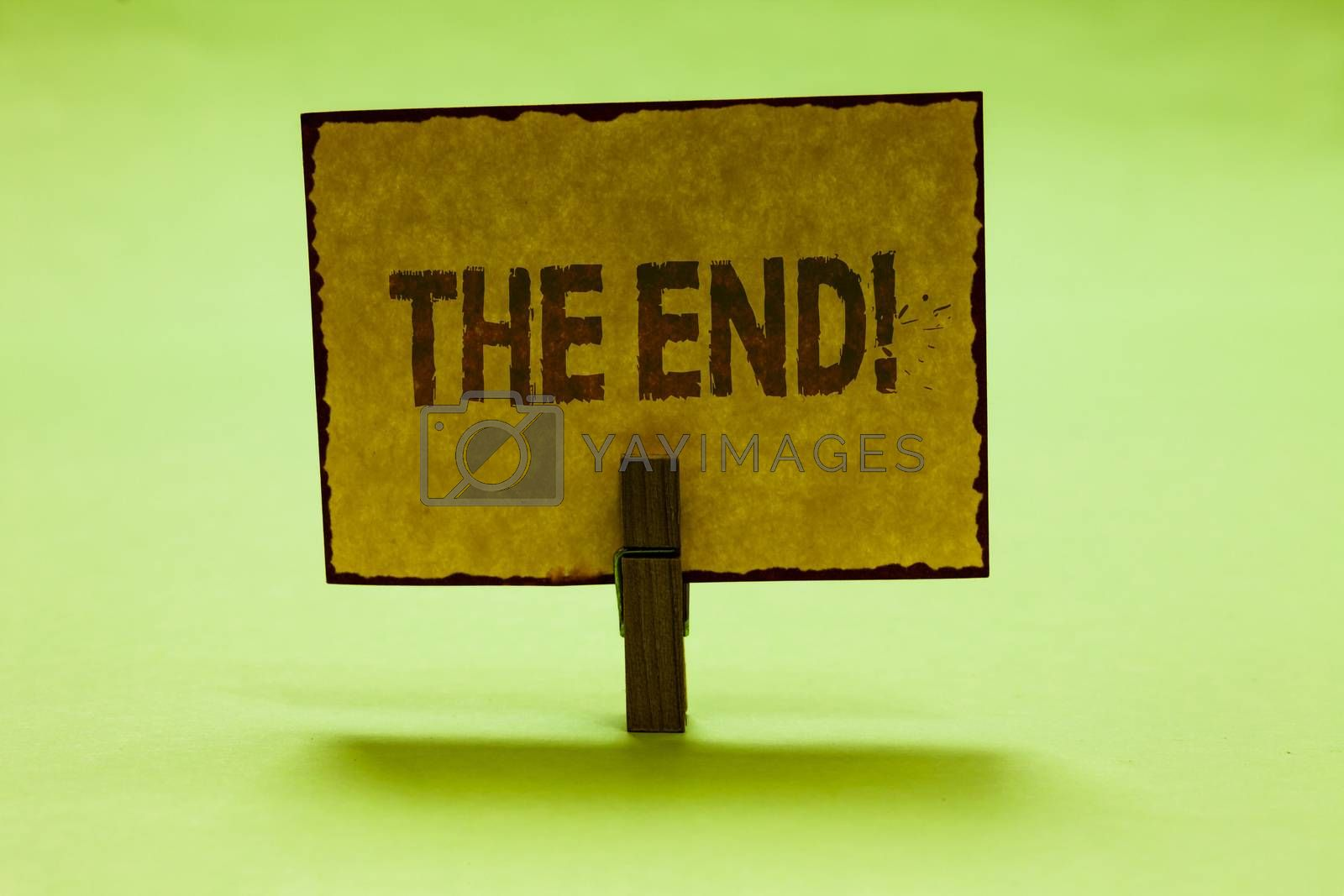 Conceptual hand writing showing The End Motivational Call. Business photo text Conclusion of time for something ending of life Nice lime colour shadow billboard important clip paperclip ideas