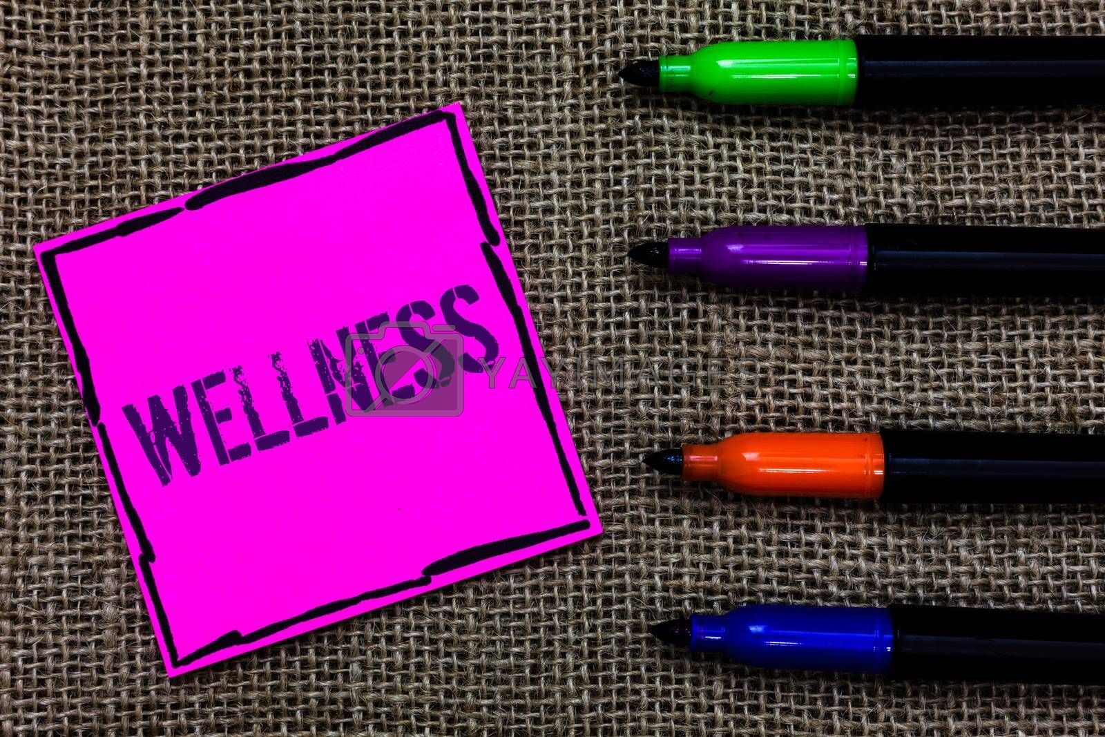 Writing note showing Wellness. Business photo showcasing Making healthy choices complete mental physical relaxation Marker pens art pink paper nice mat love thought black shadow memories. by Artur Szczybylo
