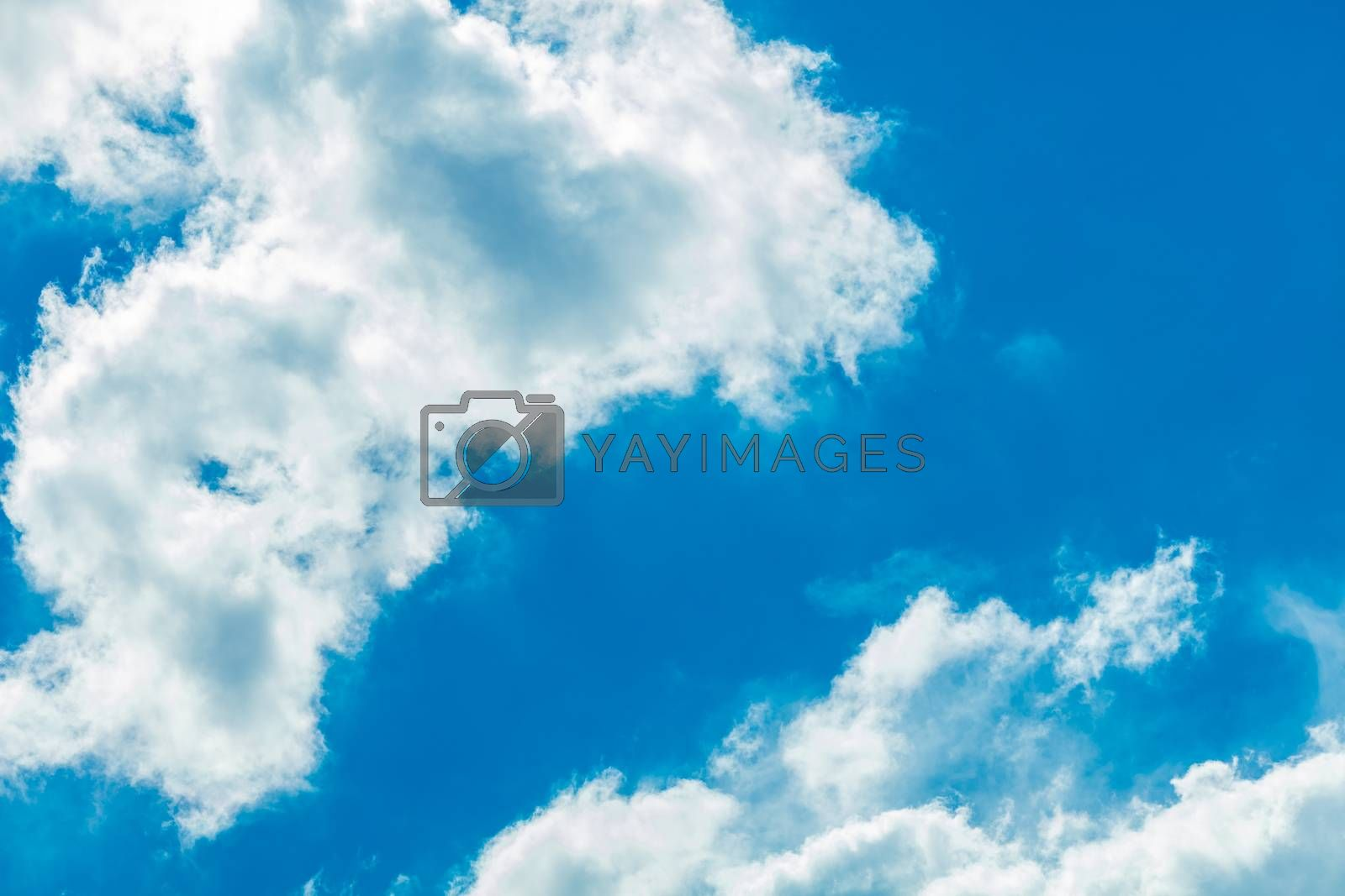 Deep blue bright sky with clouds background