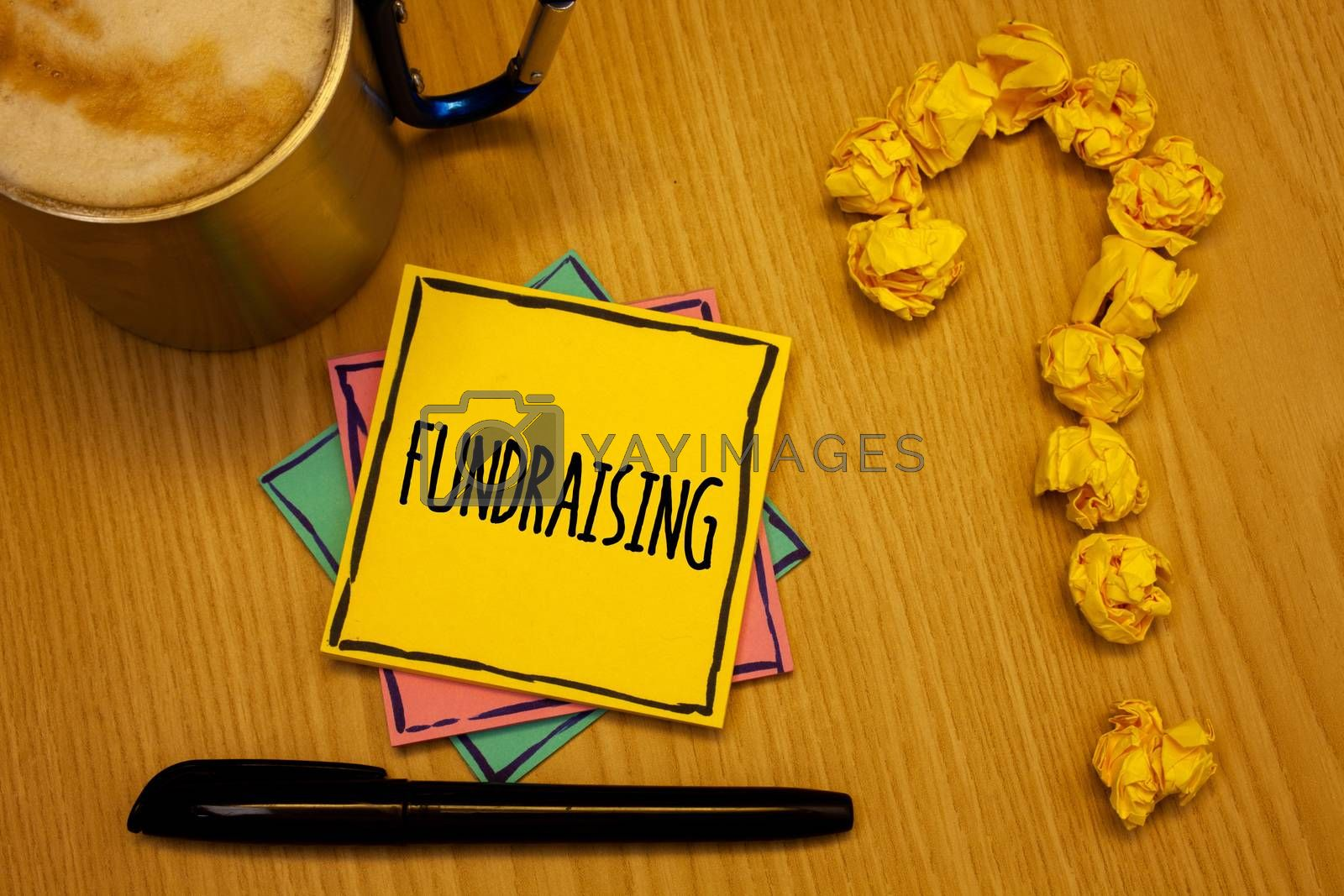Writing note showing  Fundraising. Business photo showcasing Seeking of financial support for charity cause or enterprise Message wood table coffee cup question mark crumpled papers