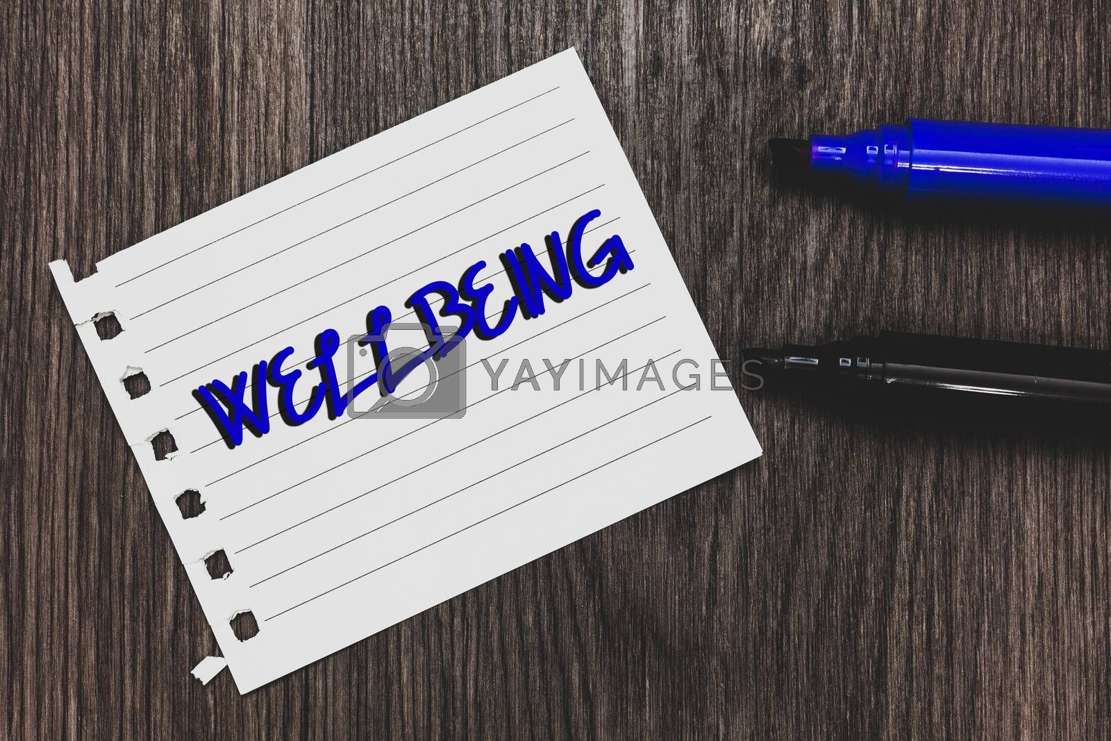 Conceptual hand writing showing Wellbeing. Business photo text Healthy lifestyle conditions of people life work balance Marker pens white paper black shadow wood ideas important tips