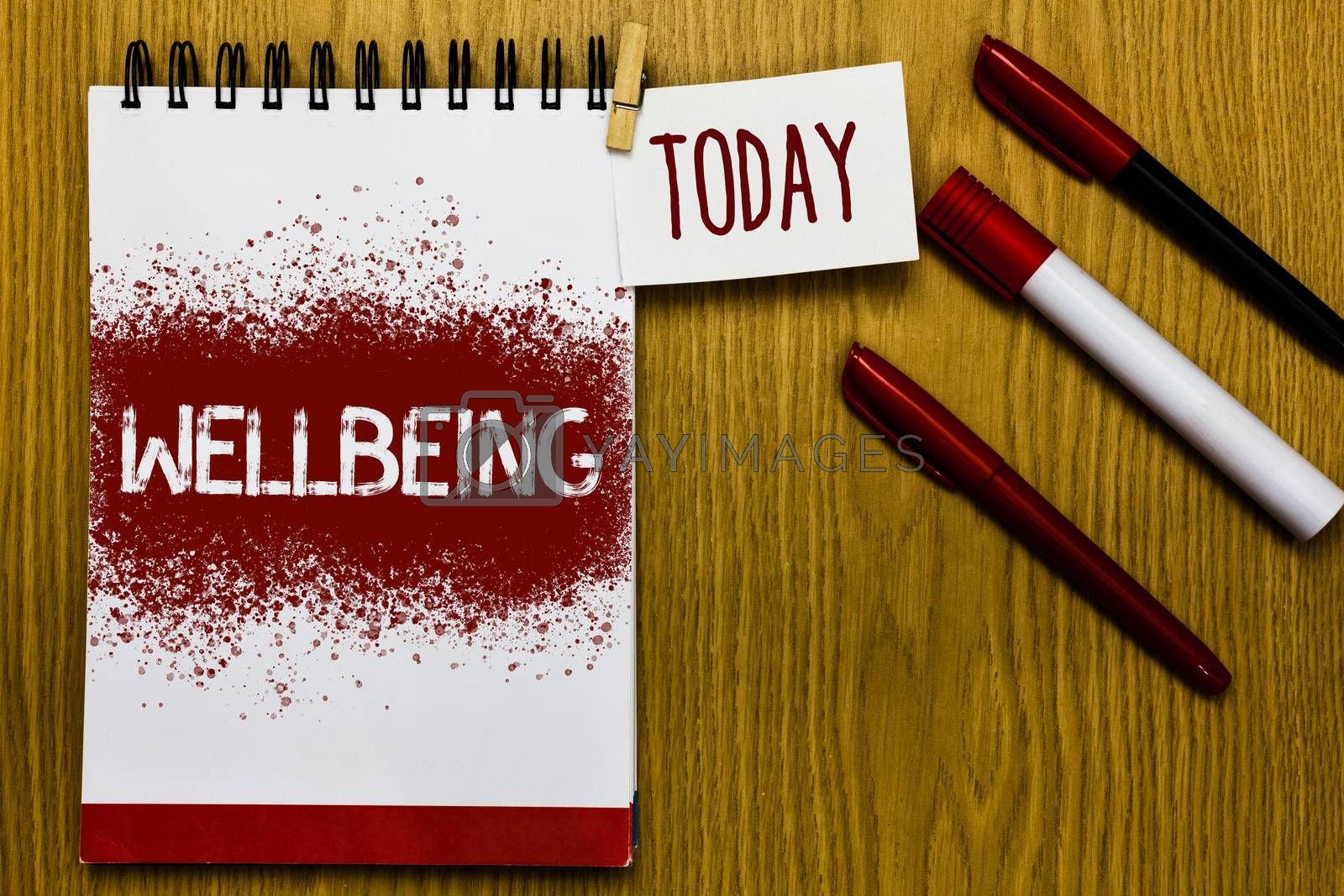 Text sign showing Wellbeing. Conceptual photo Healthy lifestyle conditions of people life work balance Reminder appointment daily note paper work book job list marker pens clip. by Artur Szczybylo