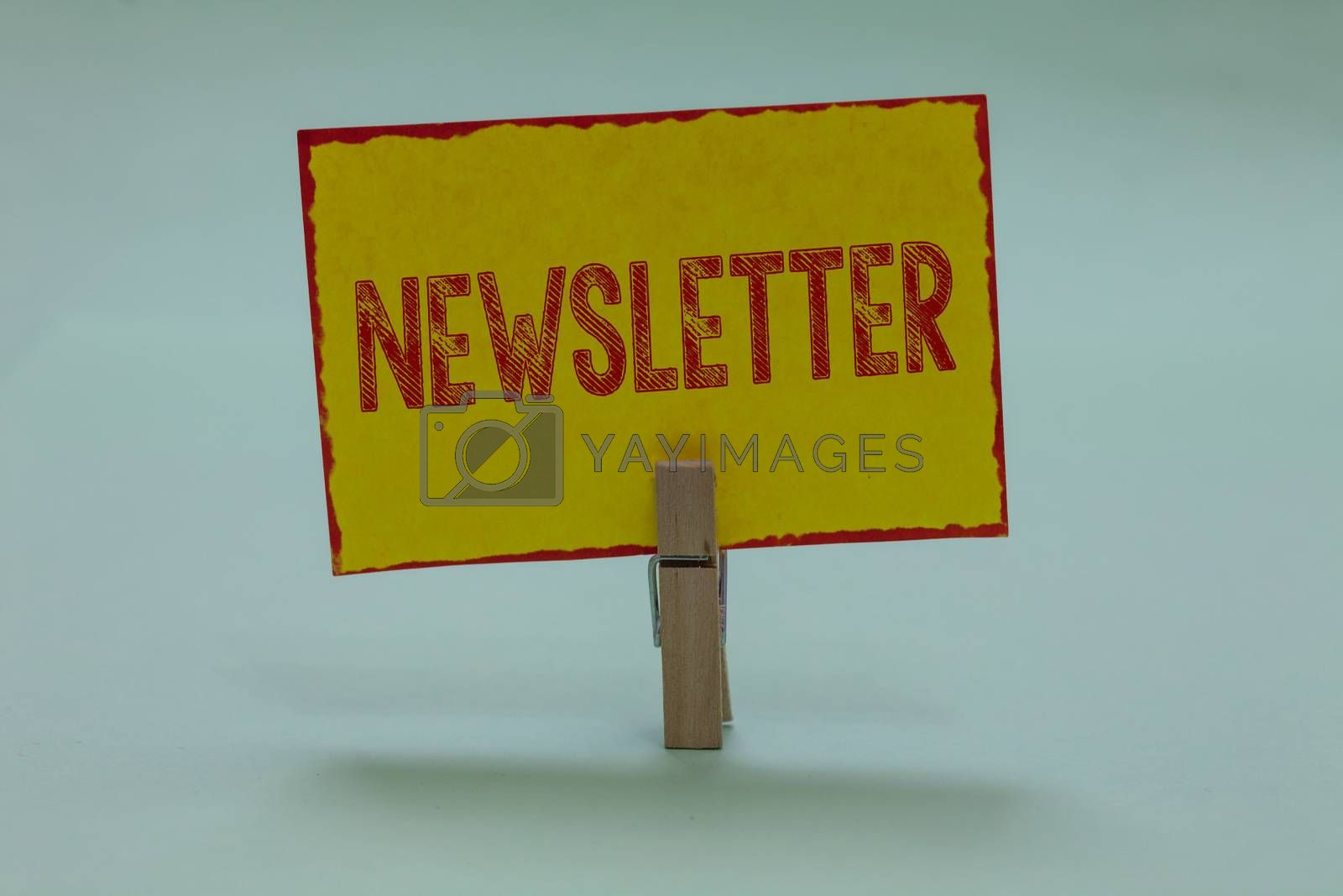 Conceptual hand writing showing Newsletter. Business photo text Bulletin periodically sent to subscribed members News report Display yellow sticky card convey messages idea notice office