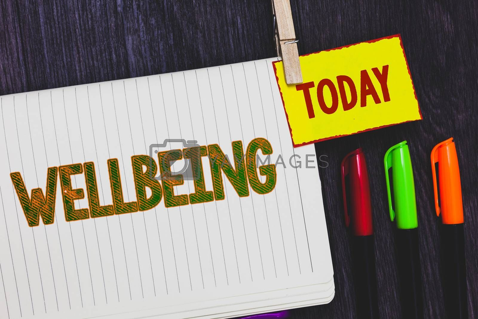 Handwriting text writing Wellbeing. Concept meaning Healthy lifestyle conditions of people life work balance Papers marker pens nice art daily creative work wood colour black shadow. by Artur Szczybylo