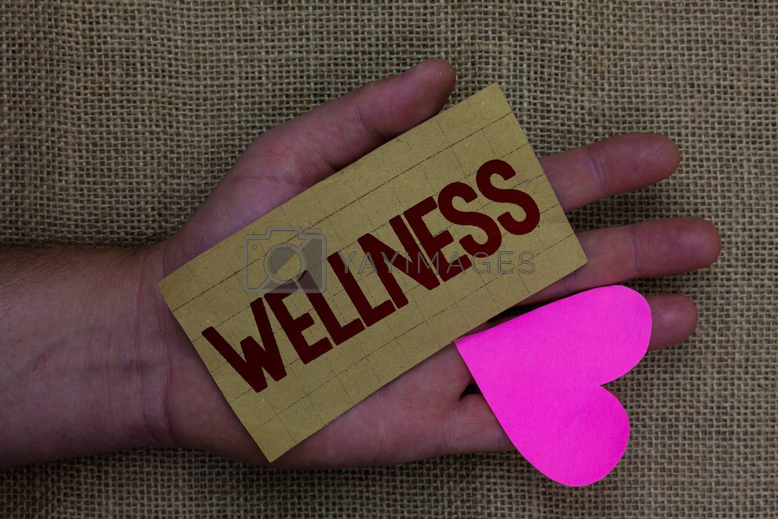 Writing note showing Wellness. Business photo showcasing Making healthy choices complete mental physical relaxation Wood art work memories lovely love thoughts mat memories hart shadow