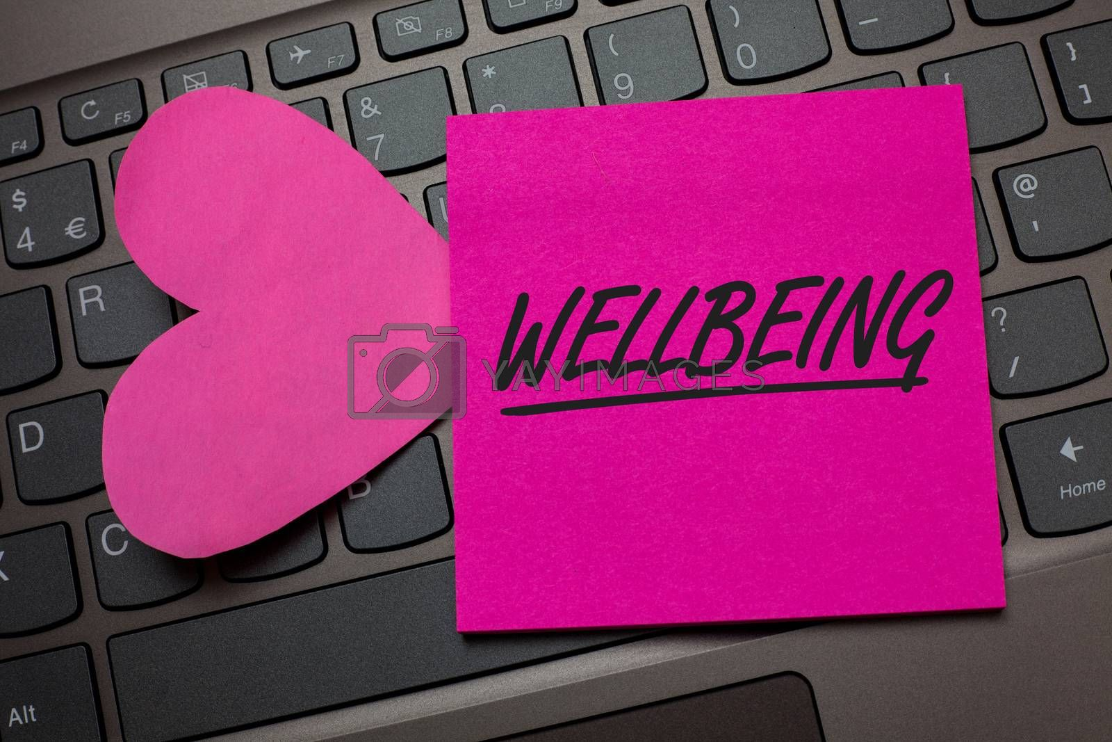 Conceptual hand writing showing Wellbeing. Business photo text Healthy lifestyle conditions of people life work balance Keyboard grey keys pink paper love idea thought computer hart