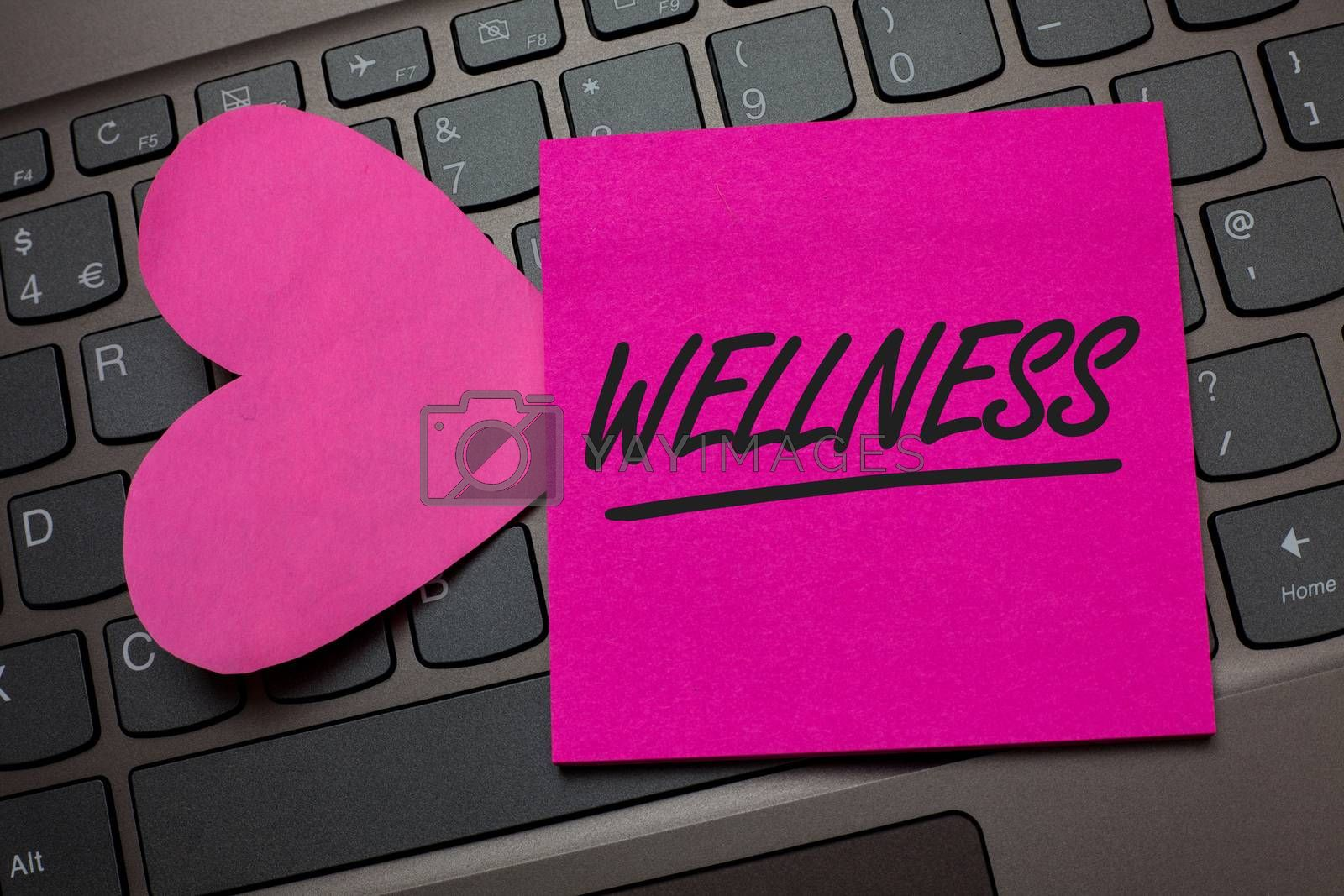 Conceptual hand writing showing Wellness. Business photo text Making healthy choices complete mental physical relaxation Keyboard grey keys pink paper love idea thought computer hart