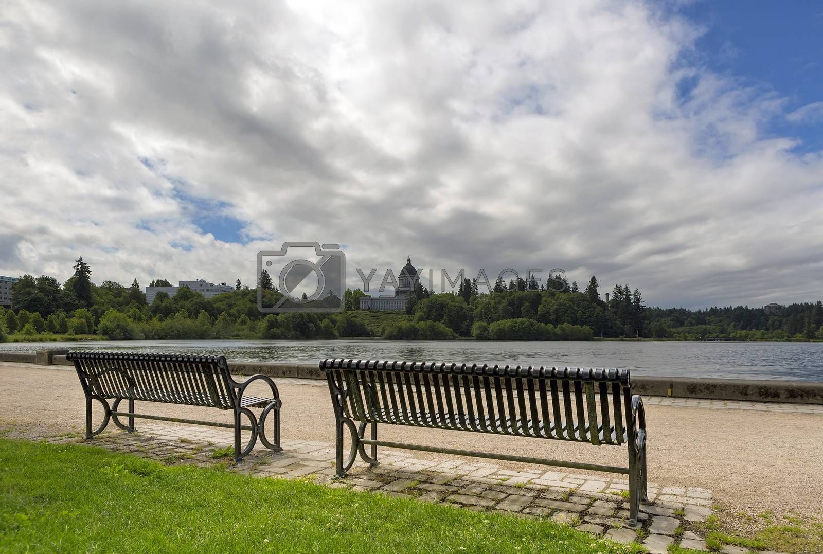 Park bench along scenic Capitol Lake in Olympia Washington State on a cloudy day