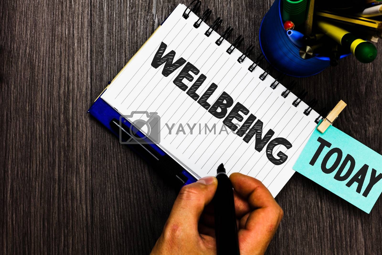 Text sign showing Wellbeing. Conceptual photo Healthy lifestyle conditions of people life work balance Reminder appointment daily work pens penholder clip paperclip papers. by Artur Szczybylo