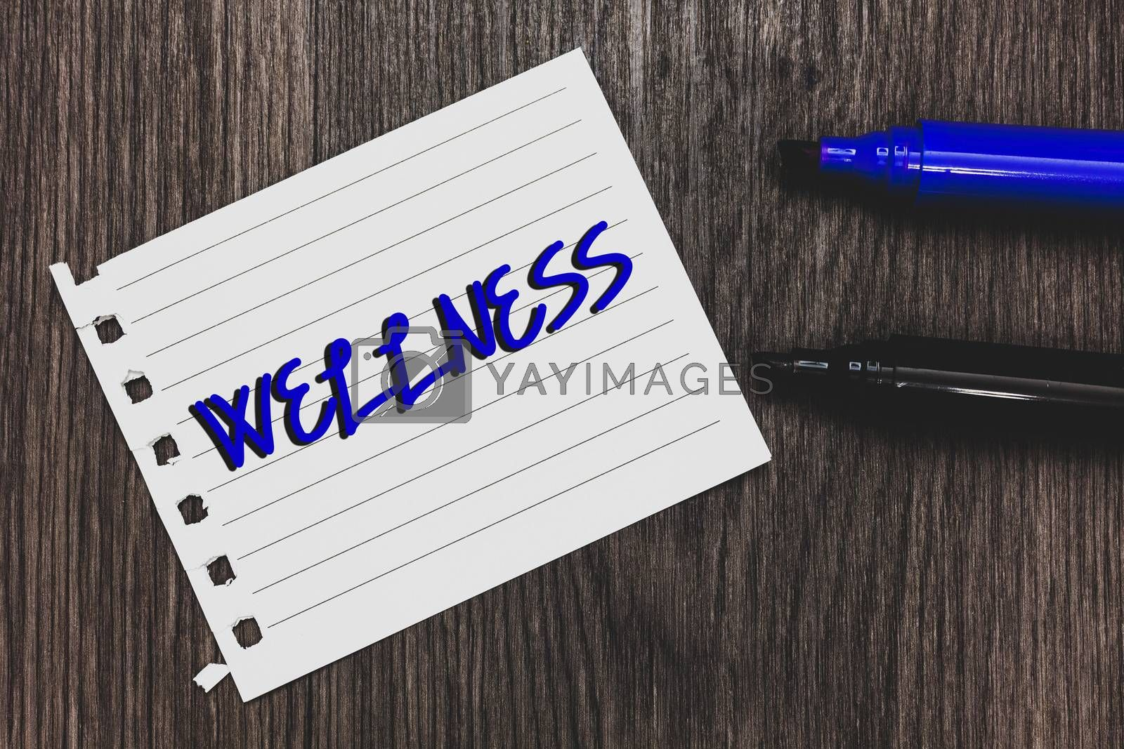 Conceptual hand writing showing Wellness. Business photo text Making healthy choices complete mental physical relaxation Marker pens white paper black shadow wood ideas important tips
