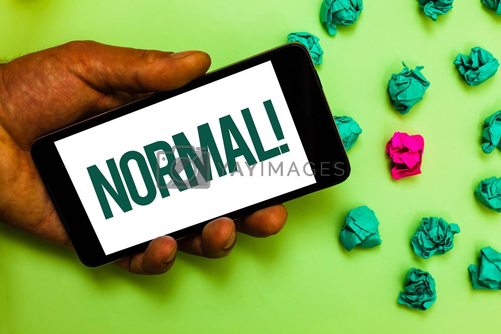 Conceptual hand writing showing Normal Motivational Call. Business photo text conforming to a standard Usual Typical or Expected Text message smart screen mobile handset crumpled small balls