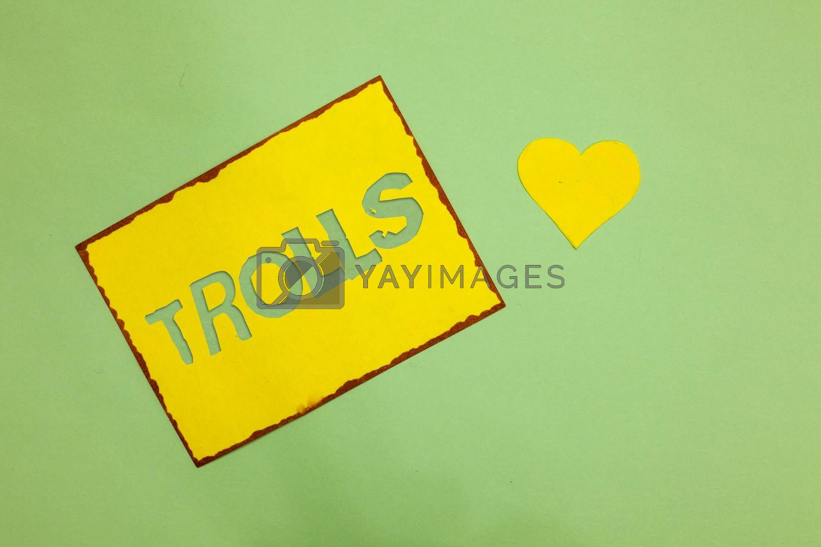 Writing note showing Trolls. Business photo showcasing Online troublemakers posting provocative inflammatory messages Nice lime colour grey shadow art paper lovely love hart romantic ideas