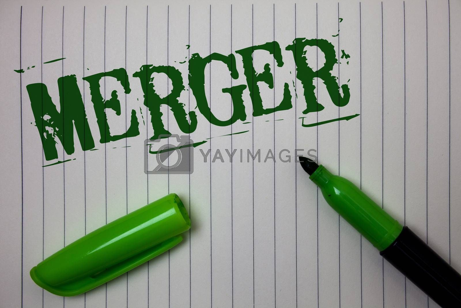 Handwriting text Merger. Concept meaning Combination of two things or companies Fusion Coalition Unification Linned paper background pen cap marker highlighter ink green drawing