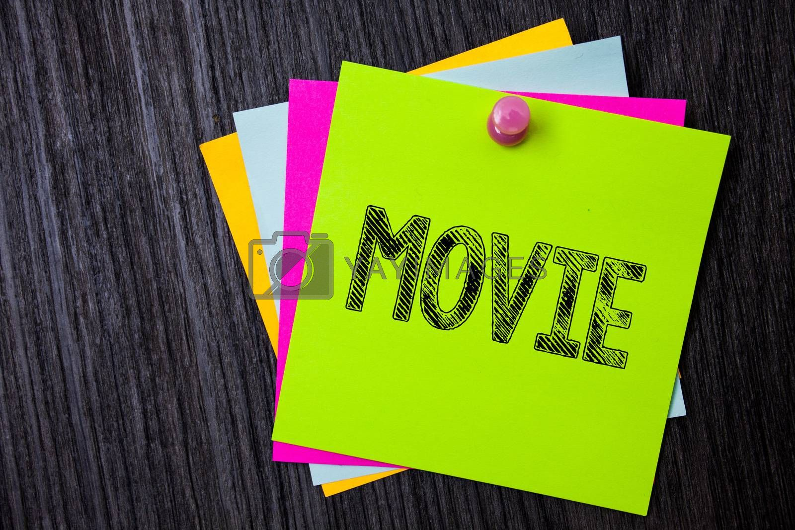 Word writing text Movie. Business concept for Cinema or television film Motion picture Video displayed on screen Multiple sticky cards pinned coclourfull dark lining background board