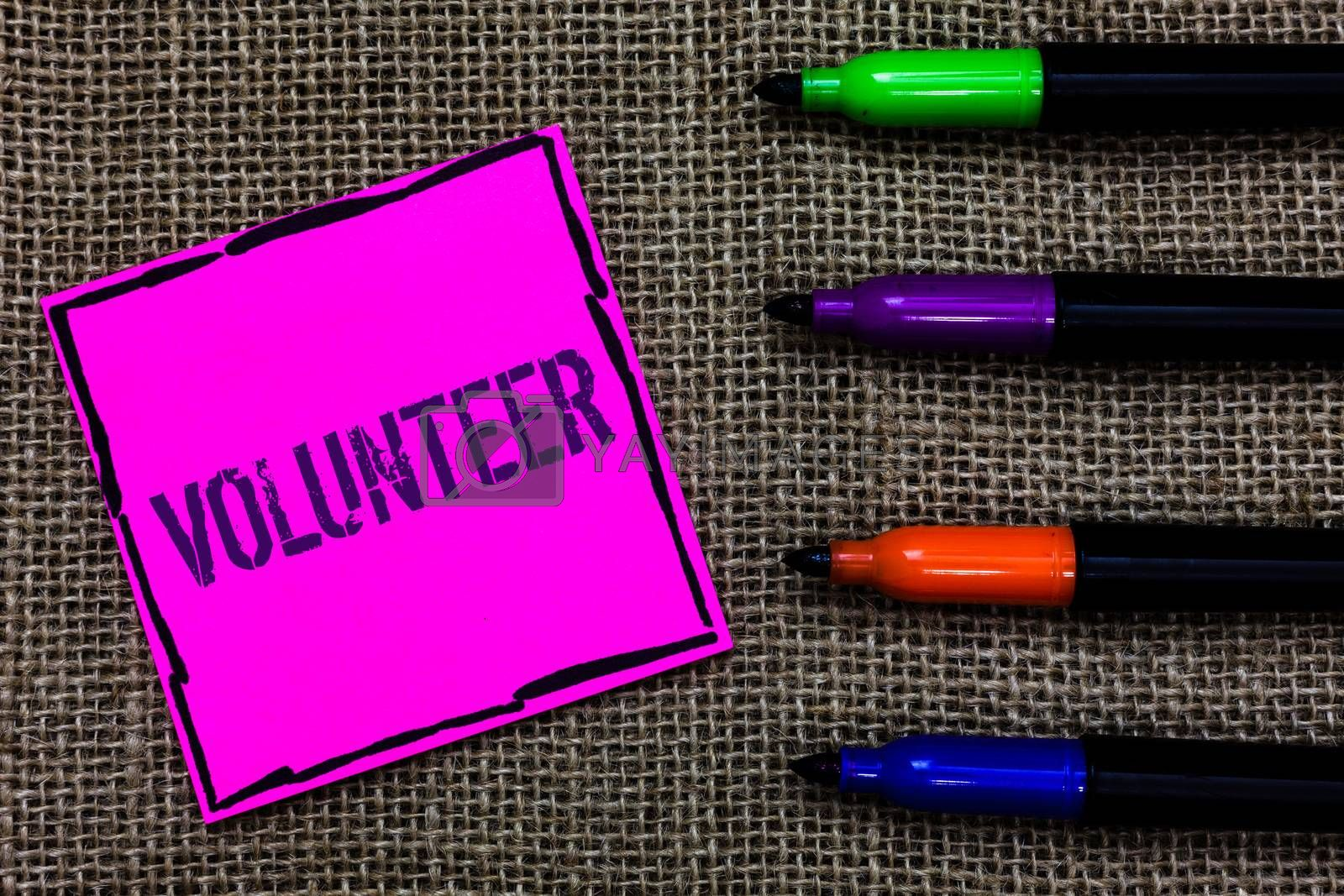 Writing note showing Volunteer. Business photo showcasing Volunteering individual for greater social cause serving others Marker pens art pink paper nice mat love thought black shadow memories