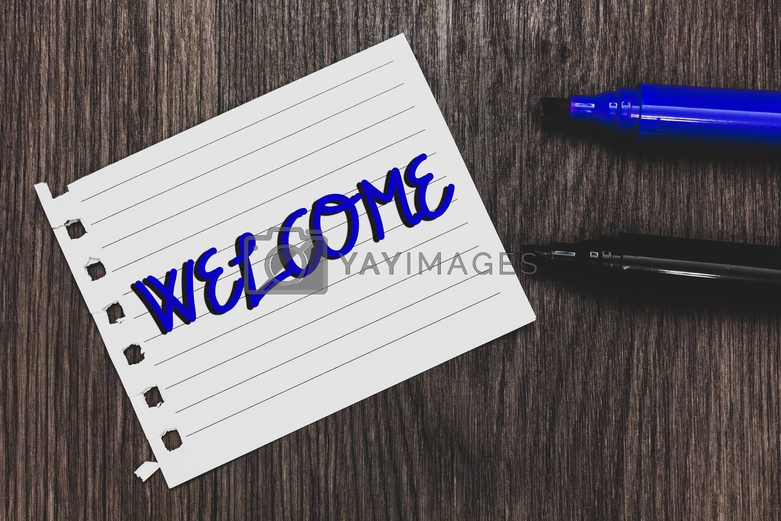 Conceptual hand writing showing Welcome. Business photo text Warm salutation acknowledgement for someone amiable loved thanked Marker pens white paper black shadow wood ideas important tips