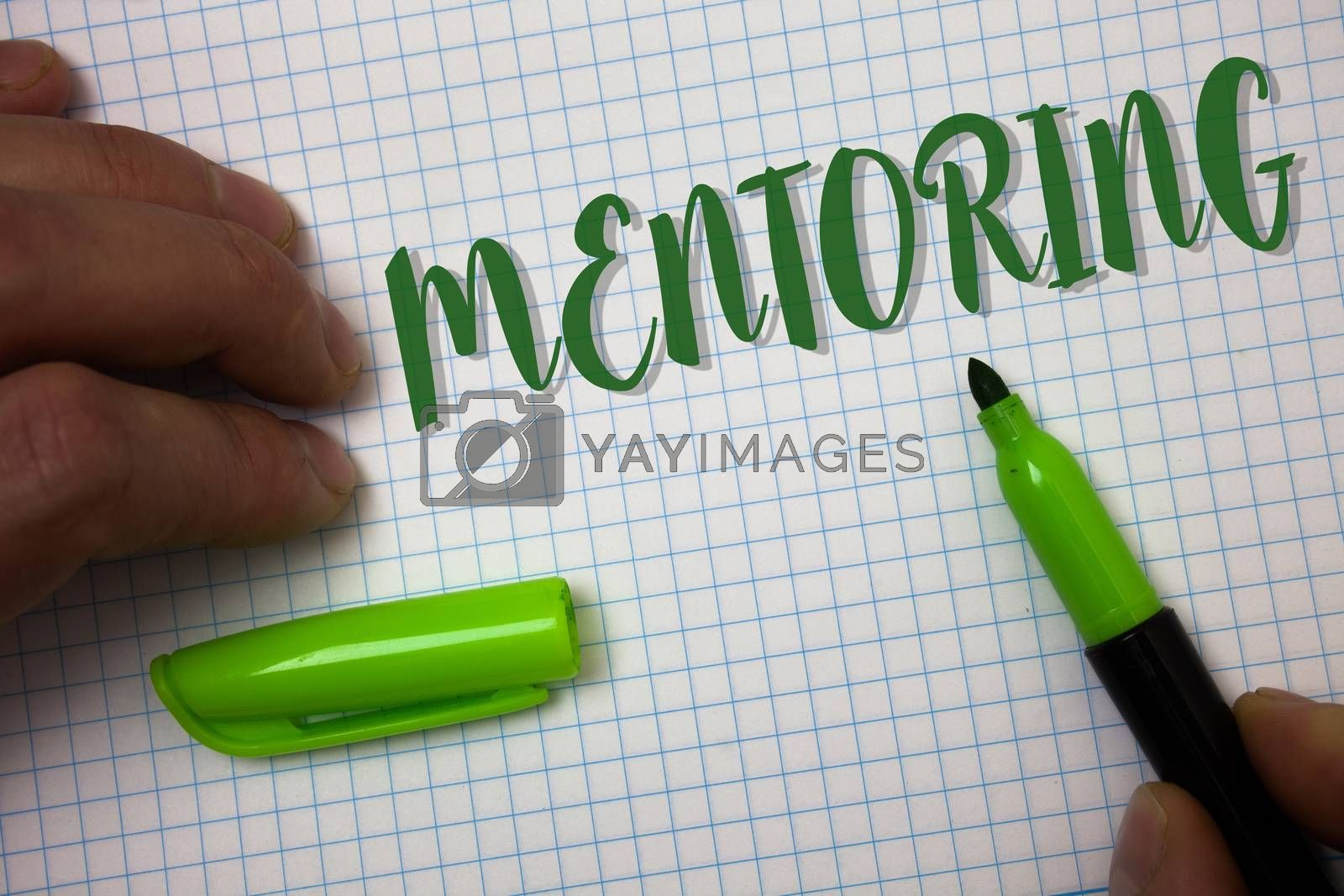 Conceptual hand writing showing Mentoring. Business photo text To give advice or support to a younger less experienced person Box background pen cap marker graphs drawing office notebook