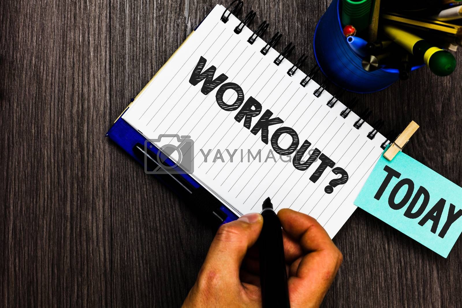 Text sign showing Workout Question. Conceptual photo Activity for wellness bodybuilding training exercising Reminder appointment daily work pens penholder clip paperclip papers. by Artur Szczybylo