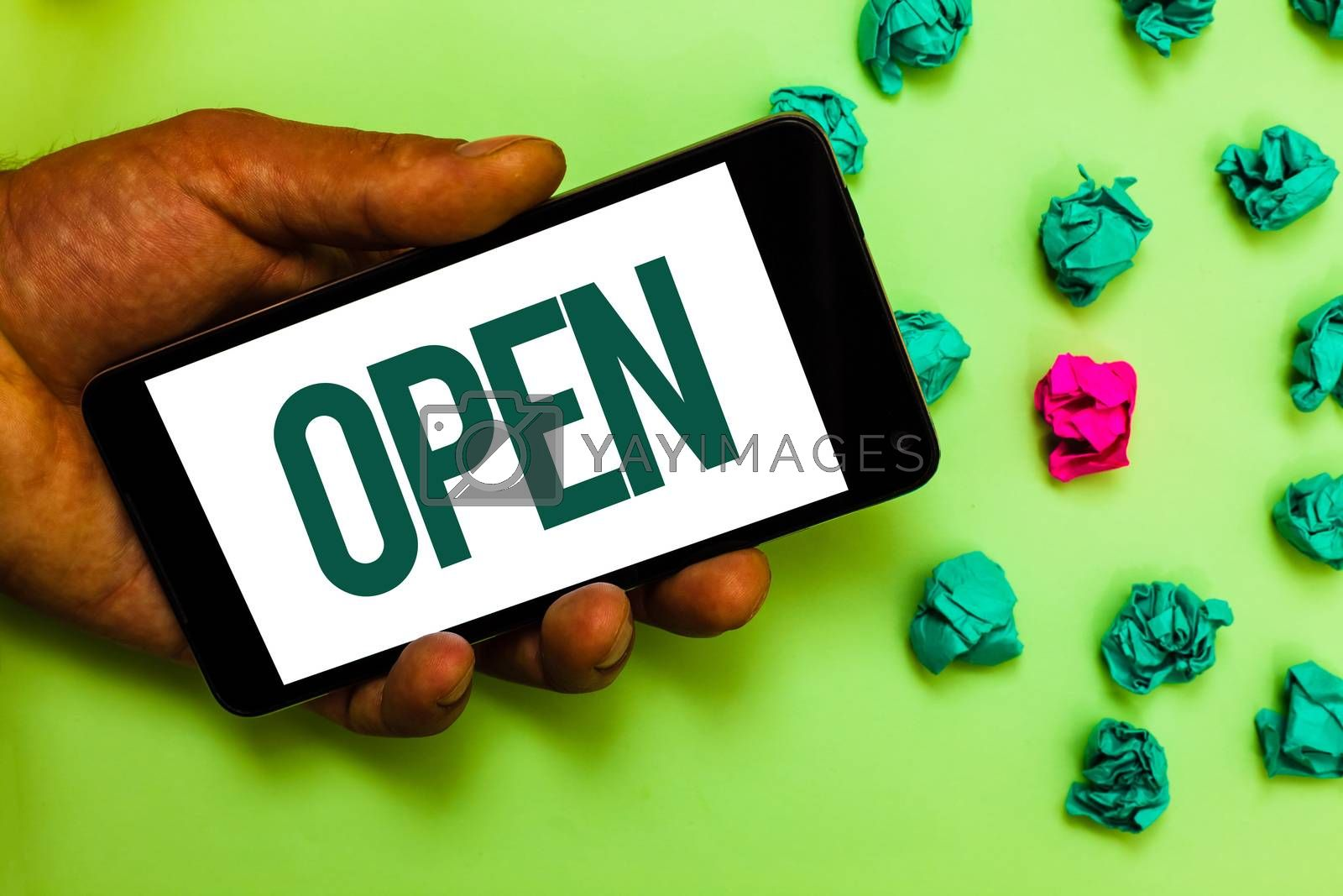 Conceptual hand writing showing Open. Business photo text Allow things to pass through or for immediate use Contrary of closed Text message smart screen mobile handset crumpled small balls