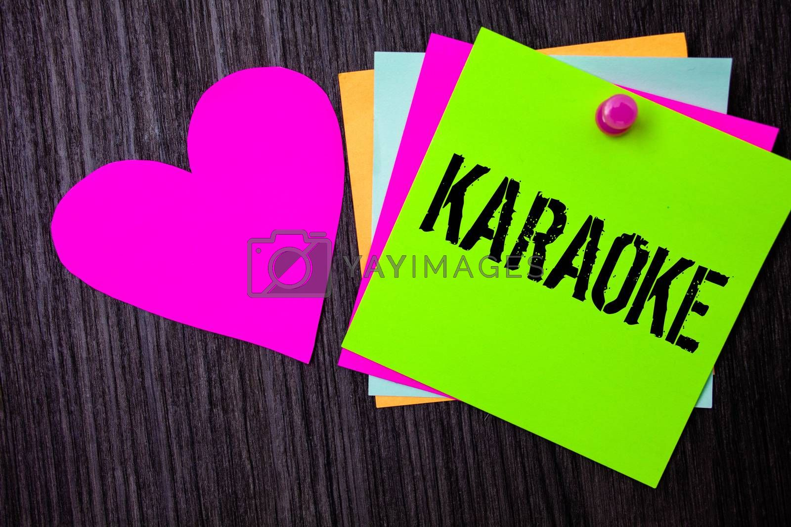 Conceptual hand writing showing Karaoke. Business photo text Entertainment singing along instrumental music played by a machine Pinned multi colour cards heart polish dark lining background