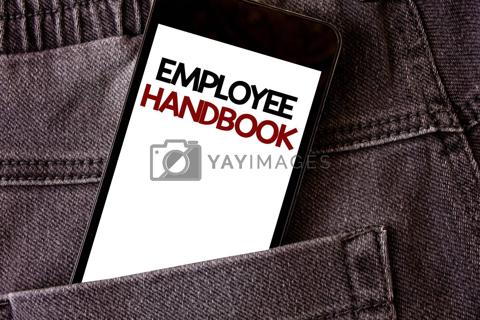 Writing note showing Employee Handbook. Business photo showcasing Document Manual Regulations Rules Guidebook Policy Code Words written black Phone white Screen Back pocket grey jeans trousers