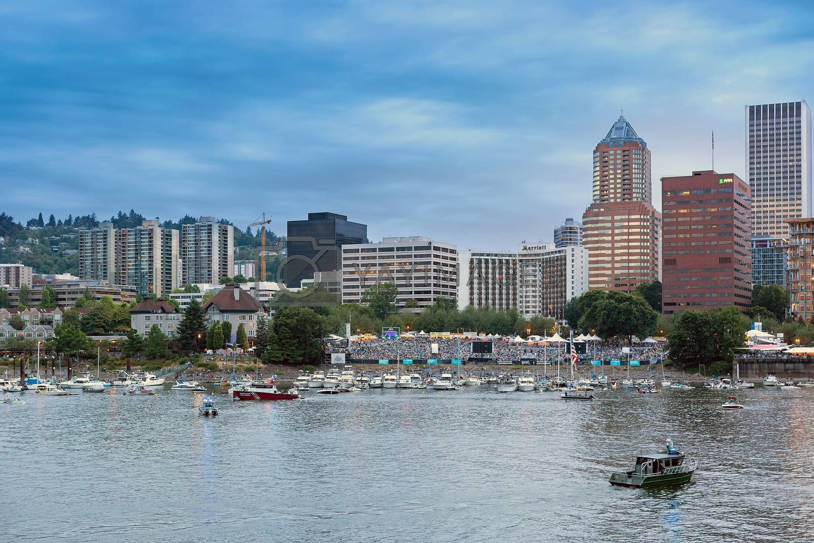 PORTLAND, OREGON - JULY 4, 2018: Portland Waterfront Blues Festival spectators along the Willamette River waterfront waiting for Indpendence Day fireworks show in downtown Portland Oregon.
