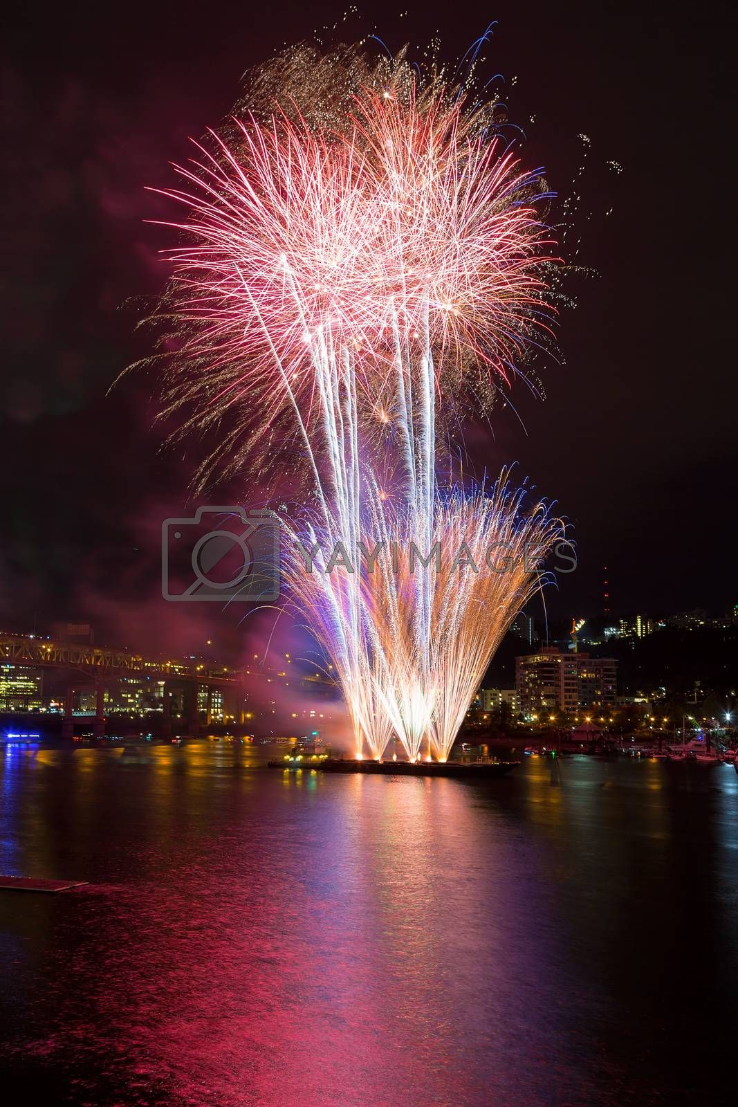 Fourth of July Independence Day fireworks display along Willamette River in downtown Portland Oregon waterfront