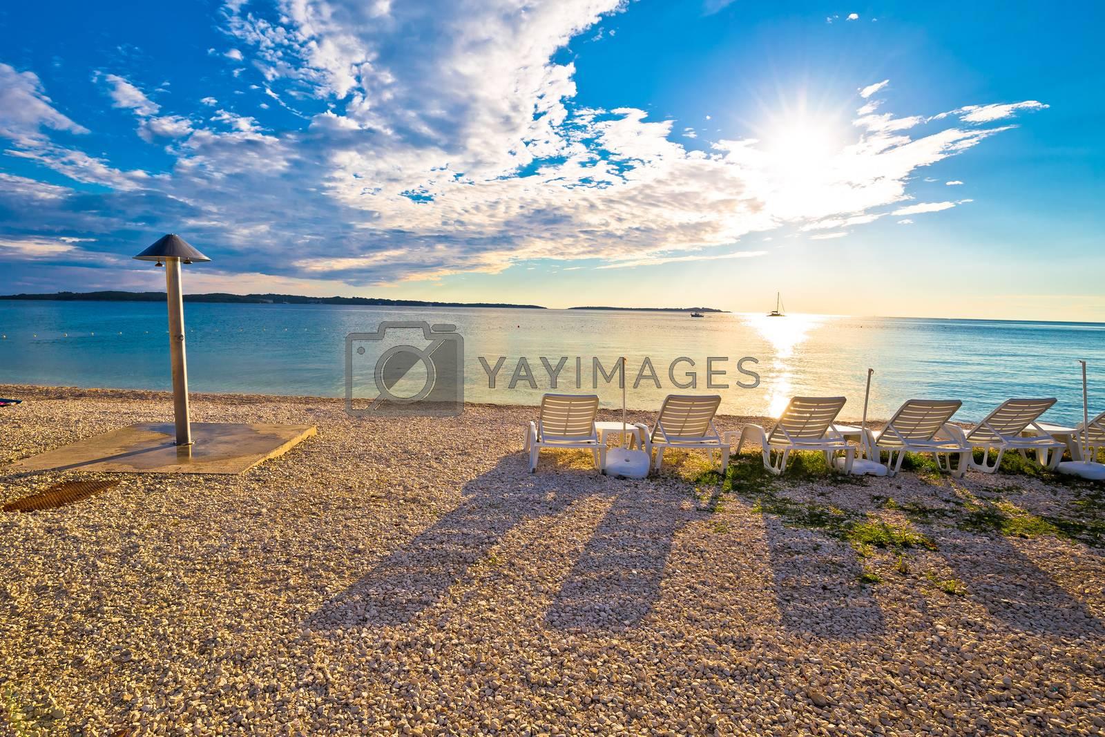 Idyllic beach near Brijuni national park sunset view, Istria region of Croatia