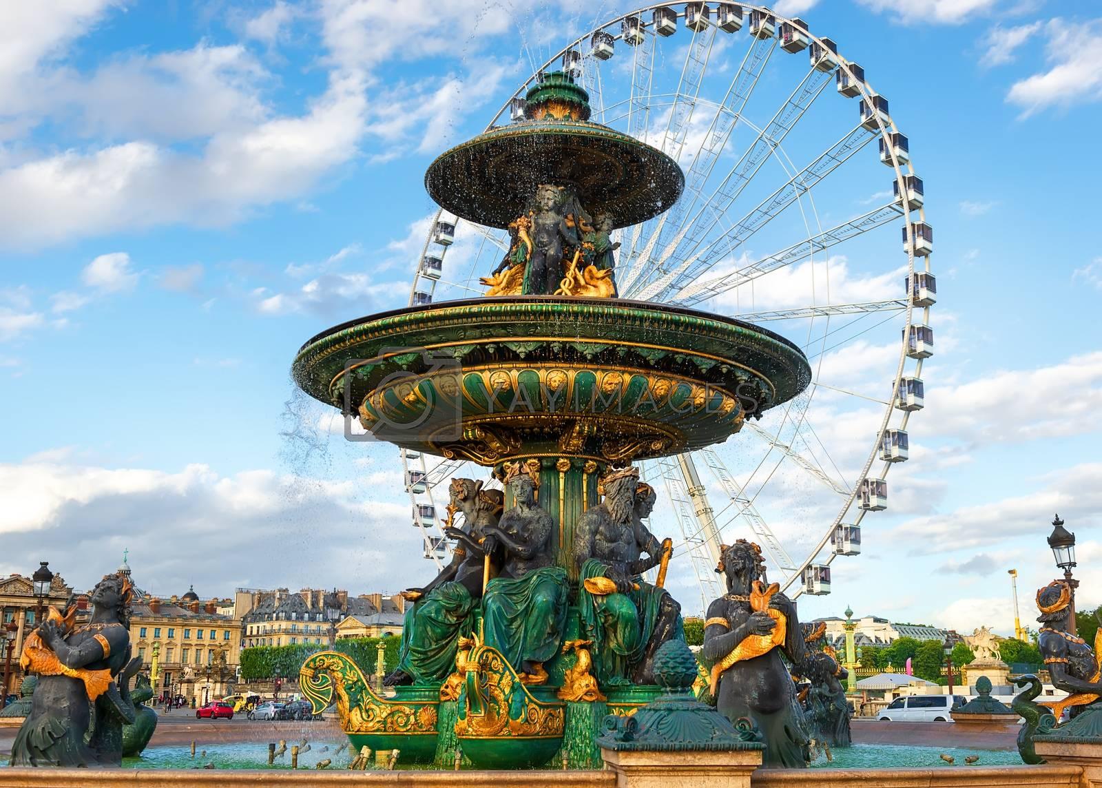 Fountain and ferris wheel in Paris at Place de la Concorde