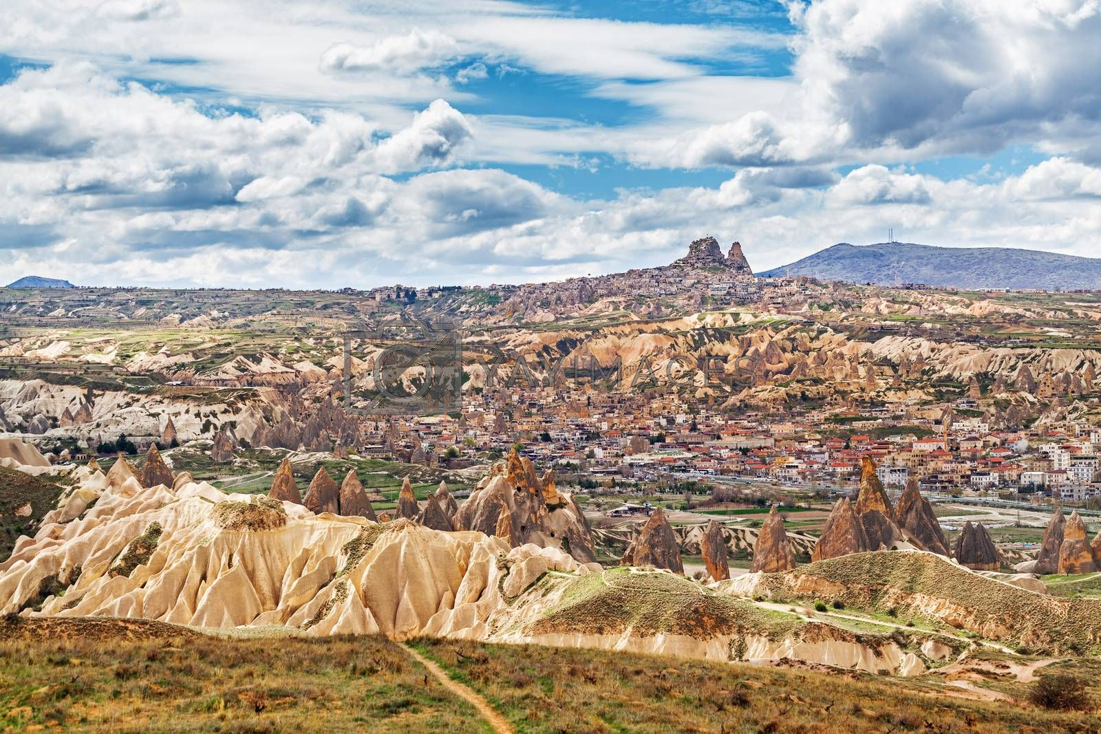 Cylindrical stone cliffs and cave houses near Goreme, Turkey