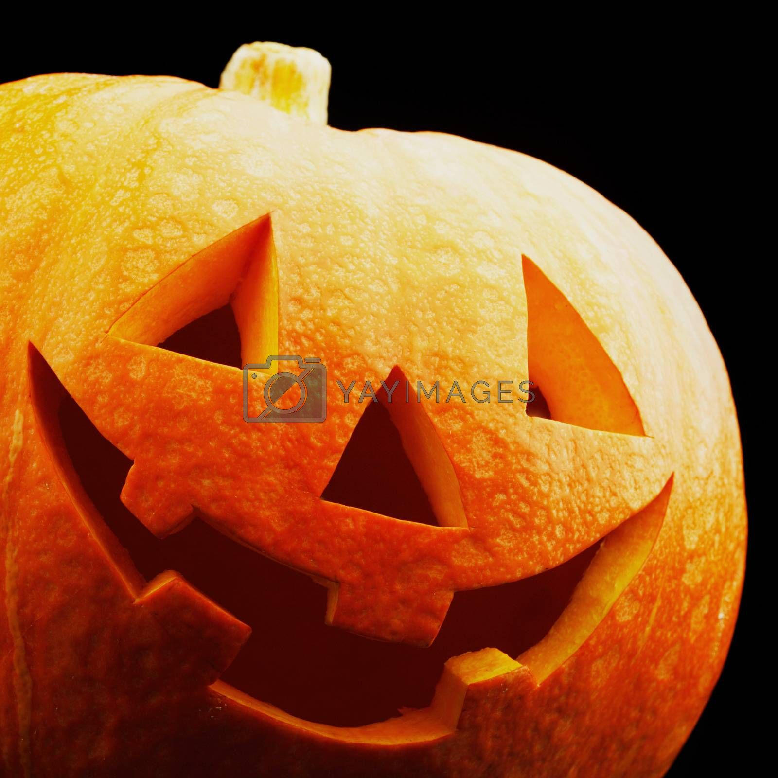 Funny Halloween pumpkin isolated on black background
