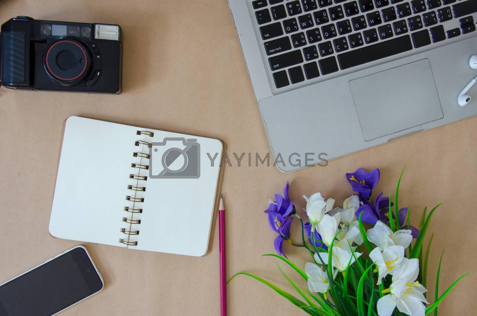 Laptops and smartphone ukulele and purple flowers
