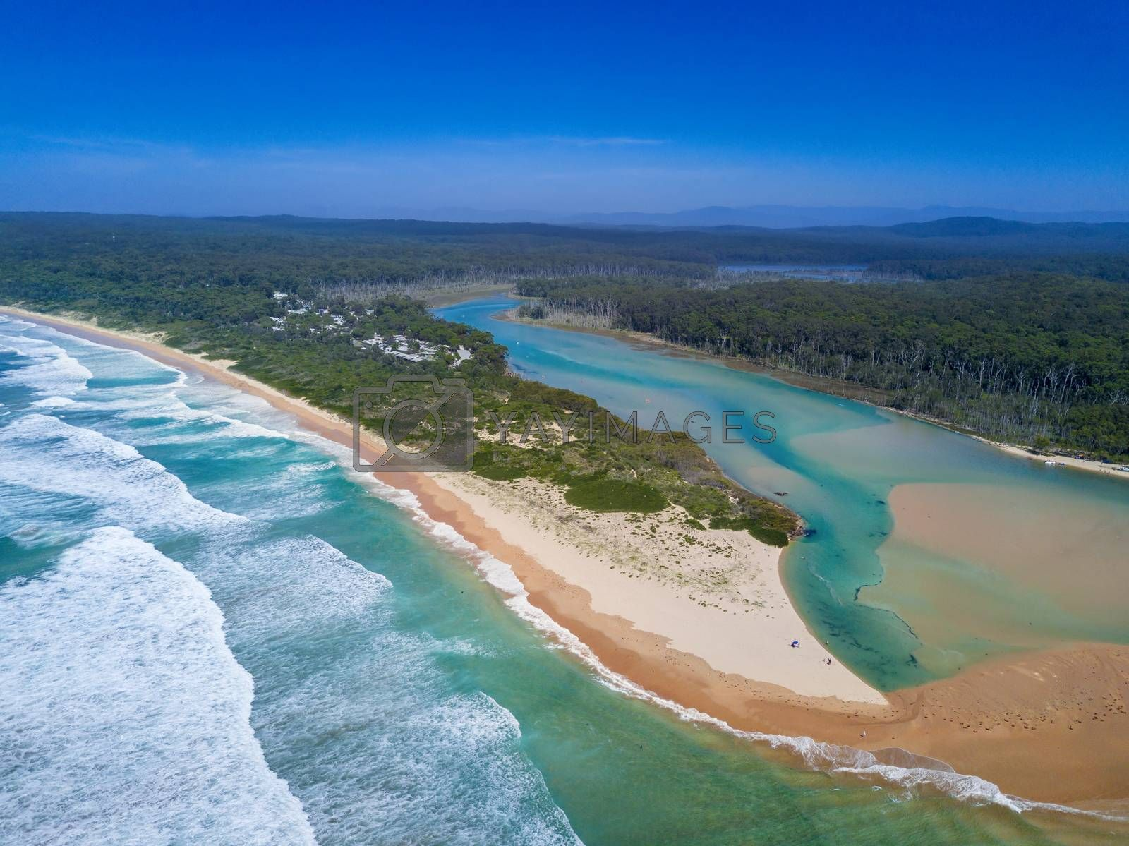 Durras lake inlet and the South Durras spit at Durras Beach on beautiful summer day