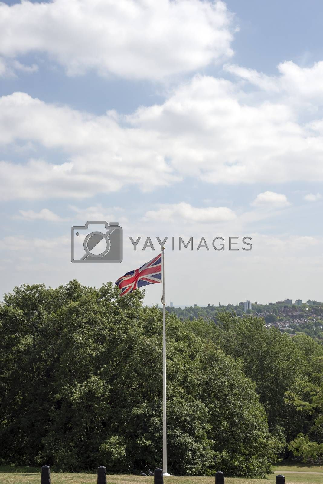 union jack flag flying from a pole in london
