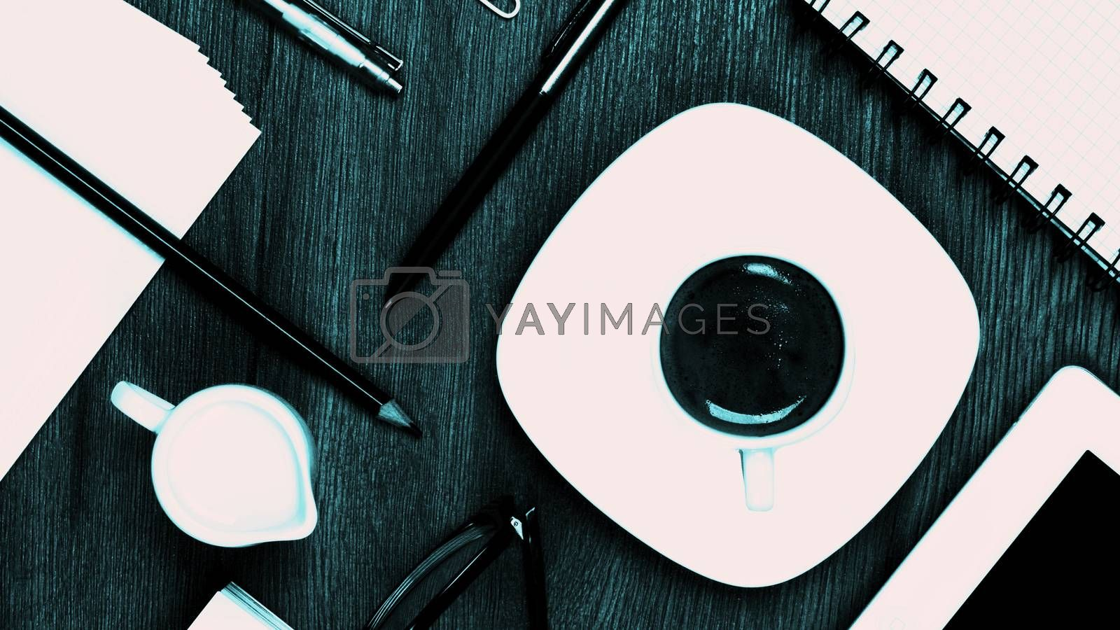 Coffee Break Concept with Stationery Items, Coffee Cup with Milk Jug, Digital Tablet and Greens Eyeglasses closeup on Wooden background. Turquoise toned