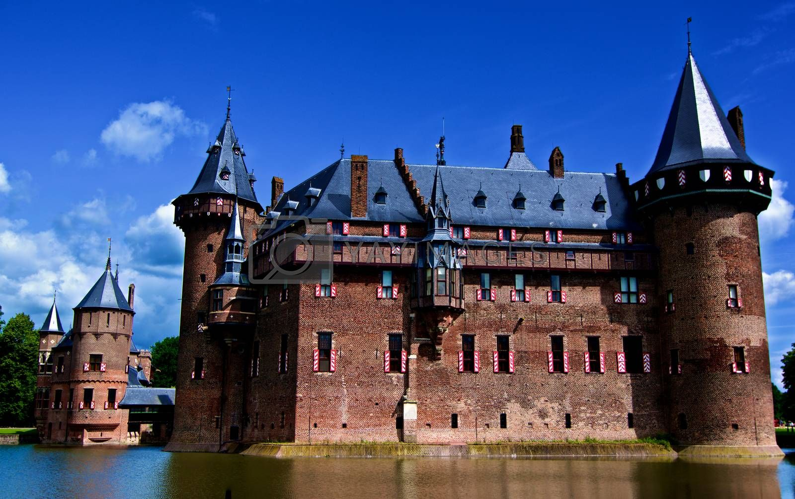 Medieval Castle De Haar from side of Moat against Blue Sky Outdoors. Utrecht, Netherlands