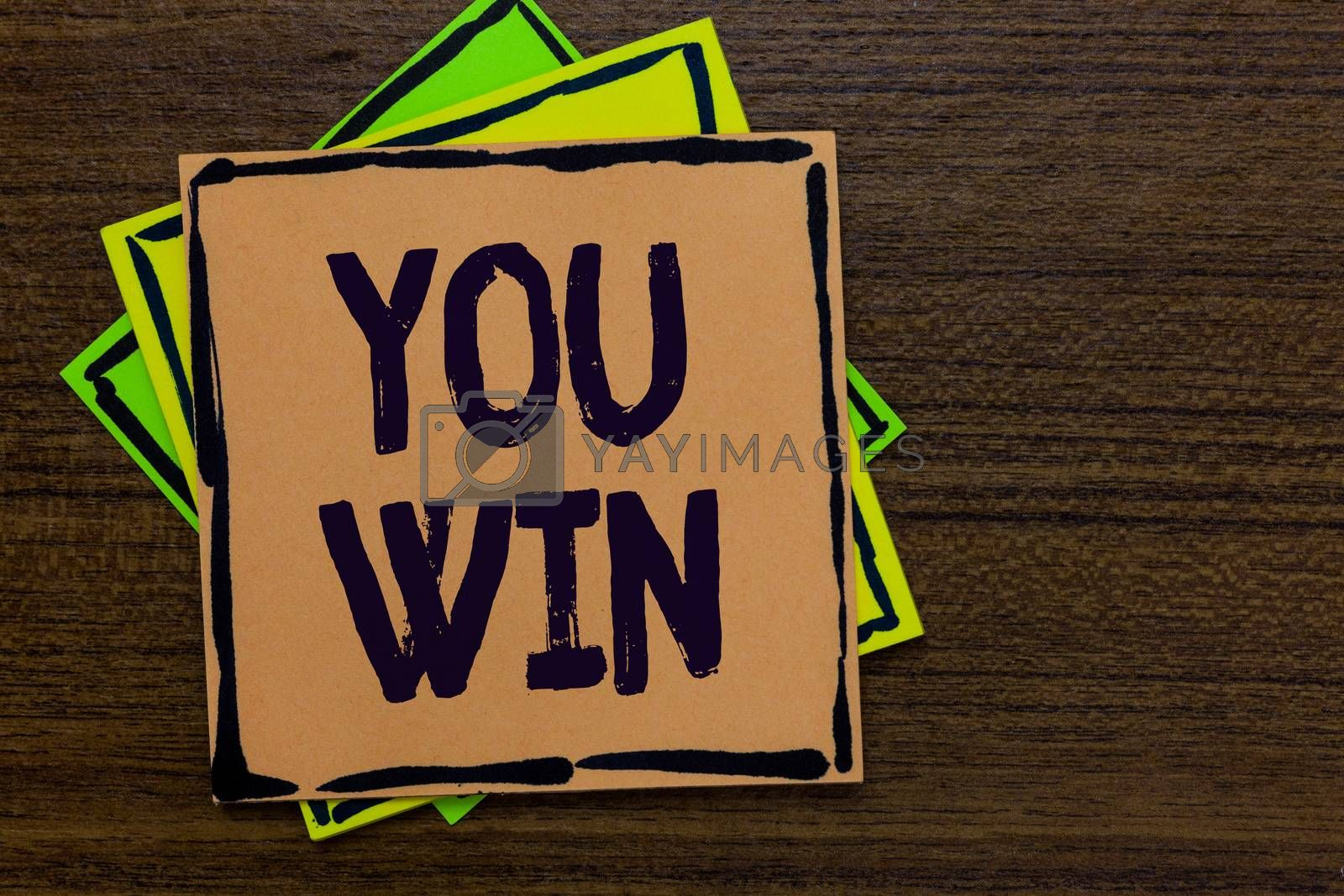 Word writing text You Win. Business concept for be first in school race or competition Got gold medal Rating Paper notes Important reminders Express ideas messages Wooden background