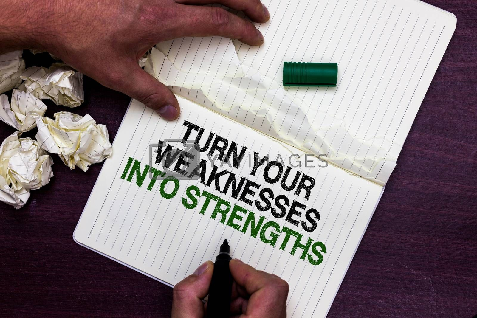 Text sign showing Turn Your Weaknesses Into Strengths. Conceptual photo work on your defects to get raid of them Man holding marker notebook page crumpled papers several tries mistakes