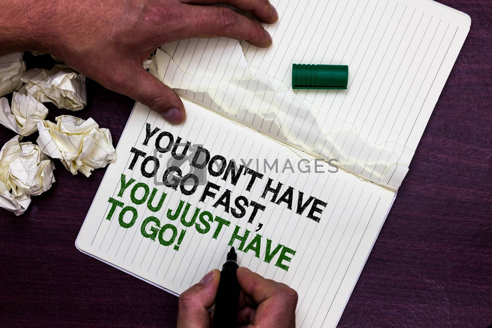 Text sign showing You Don t not Have To Go Fast, You Just Have To Go. Conceptual photo just start to reach Man holding marker notebook page crumpled papers several tries mistakes