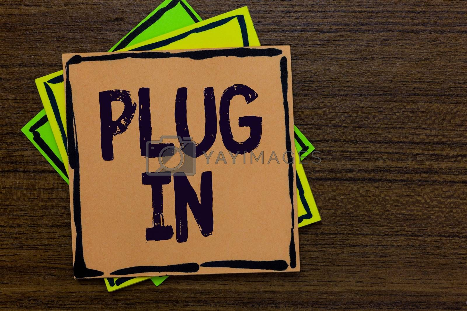 Word writing text Plug In. Business concept for putting device into electricity to turn it on Power it Connecting Paper notes Important reminders Express ideas messages Wooden background