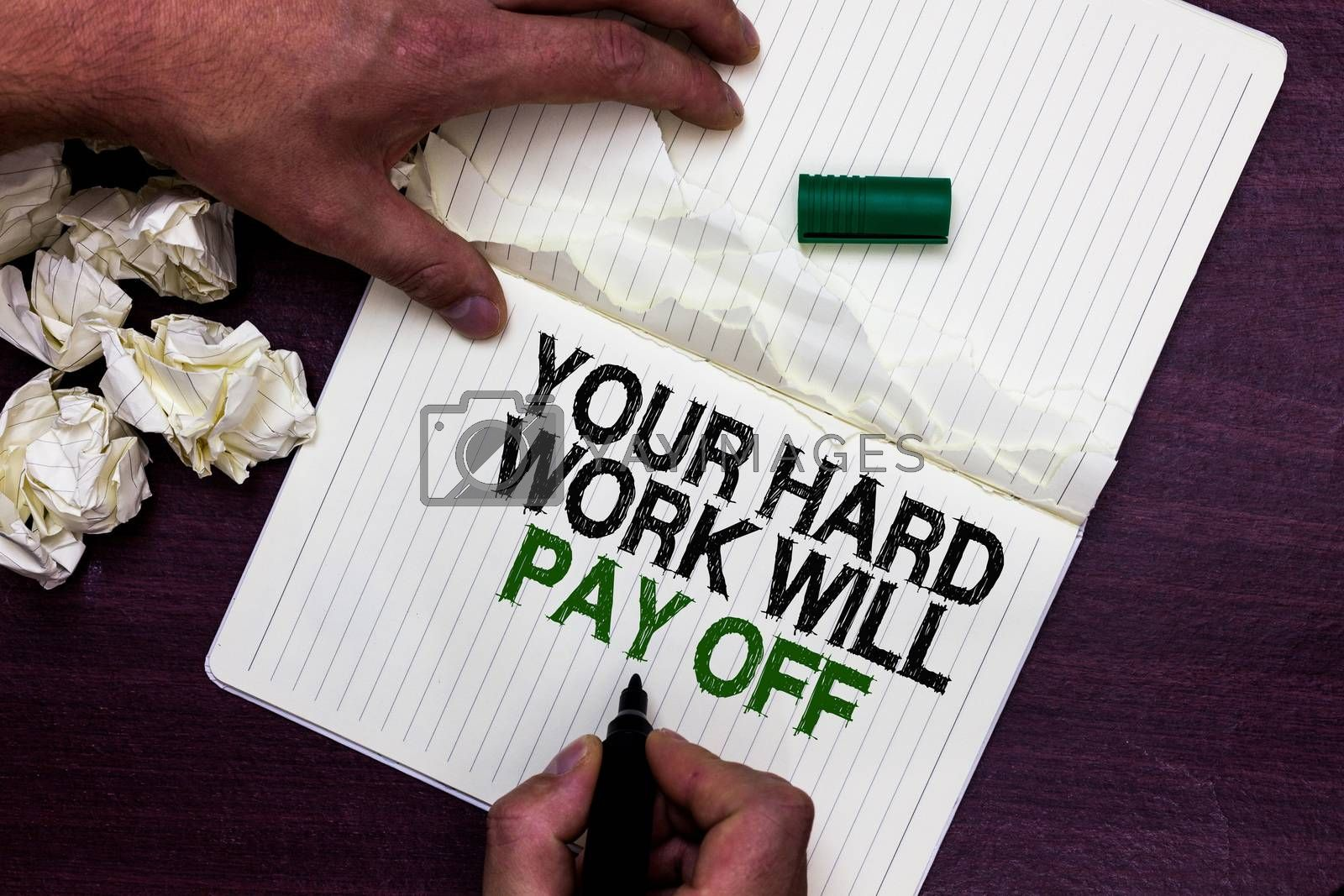 Text sign showing Your Hard Work Will Pay Off. Conceptual photo increasing work effort will lead to great things Man holding marker notebook page crumpled papers several tries mistakes