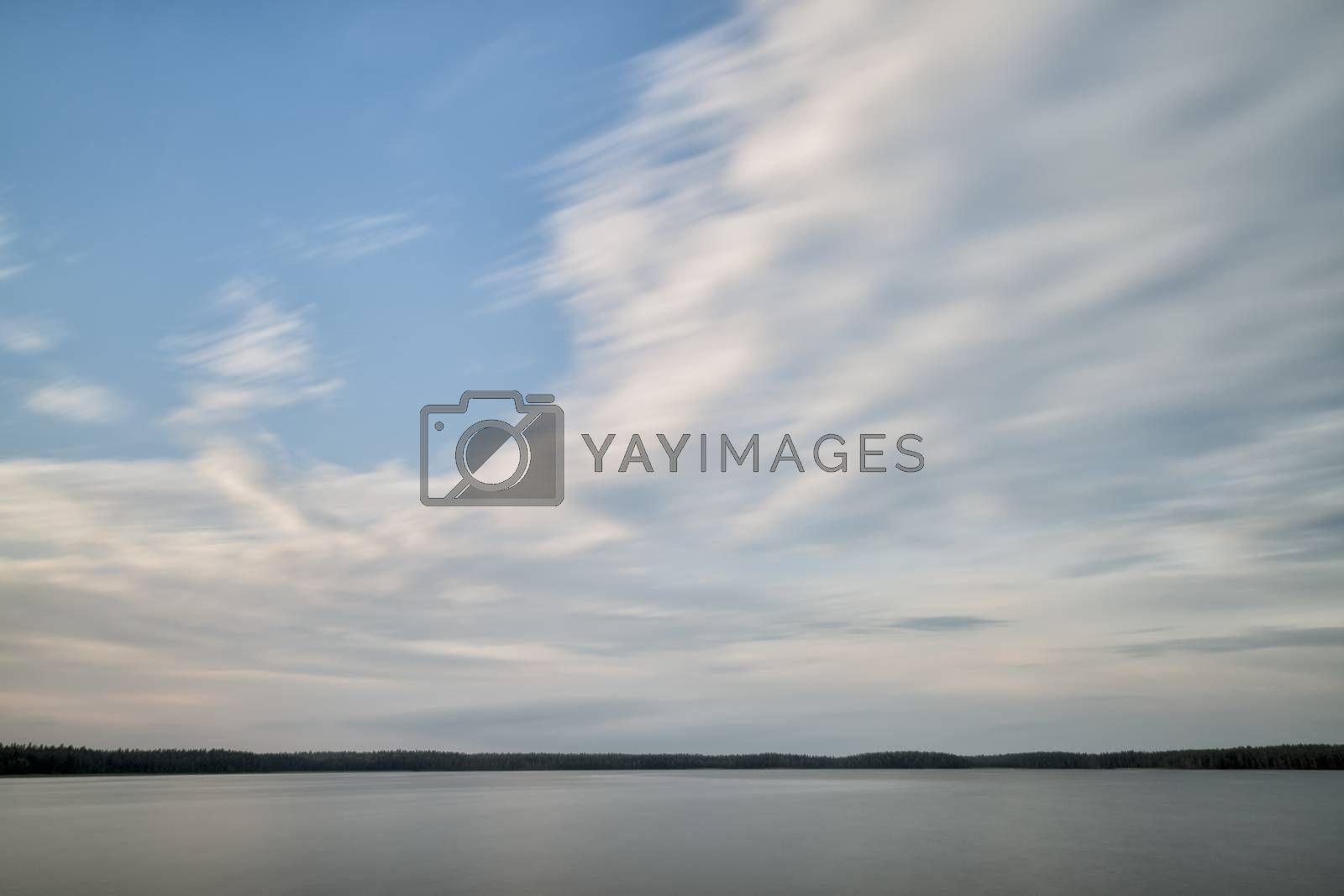 Lake with clouds and Calm Water and trees.